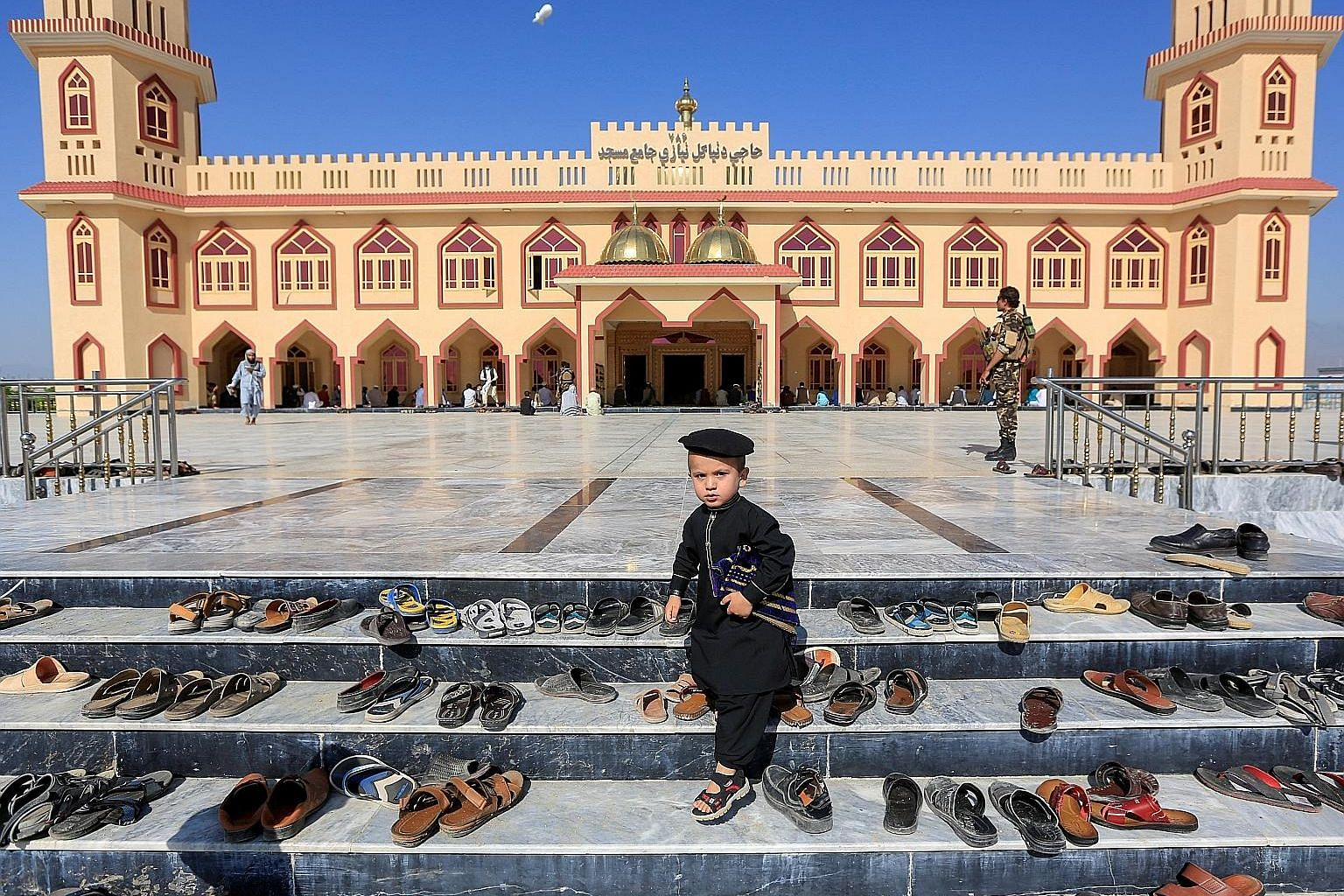 An Afghan boy outside a mosque during the Eid al-Fitr holiday in Laghman province, Afghanistan, yesterday. The Taleban made a three-day truce offer that started on Sunday to mark the holiday - a move swiftly welcomed by the Afghan government.