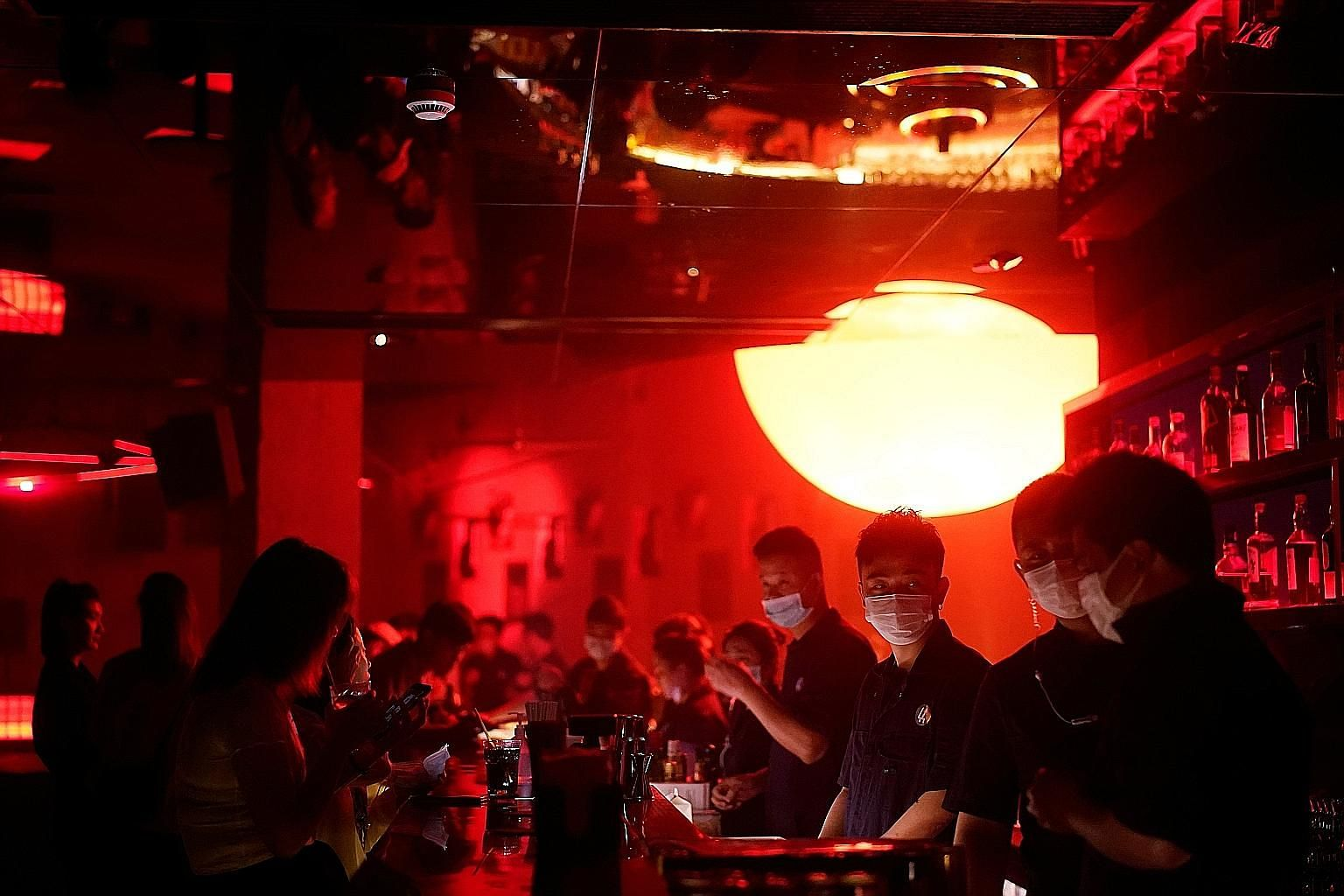 People with face masks at a nightclub after it reopened in Shanghai, China, last Friday. PHOTO: REUTERS