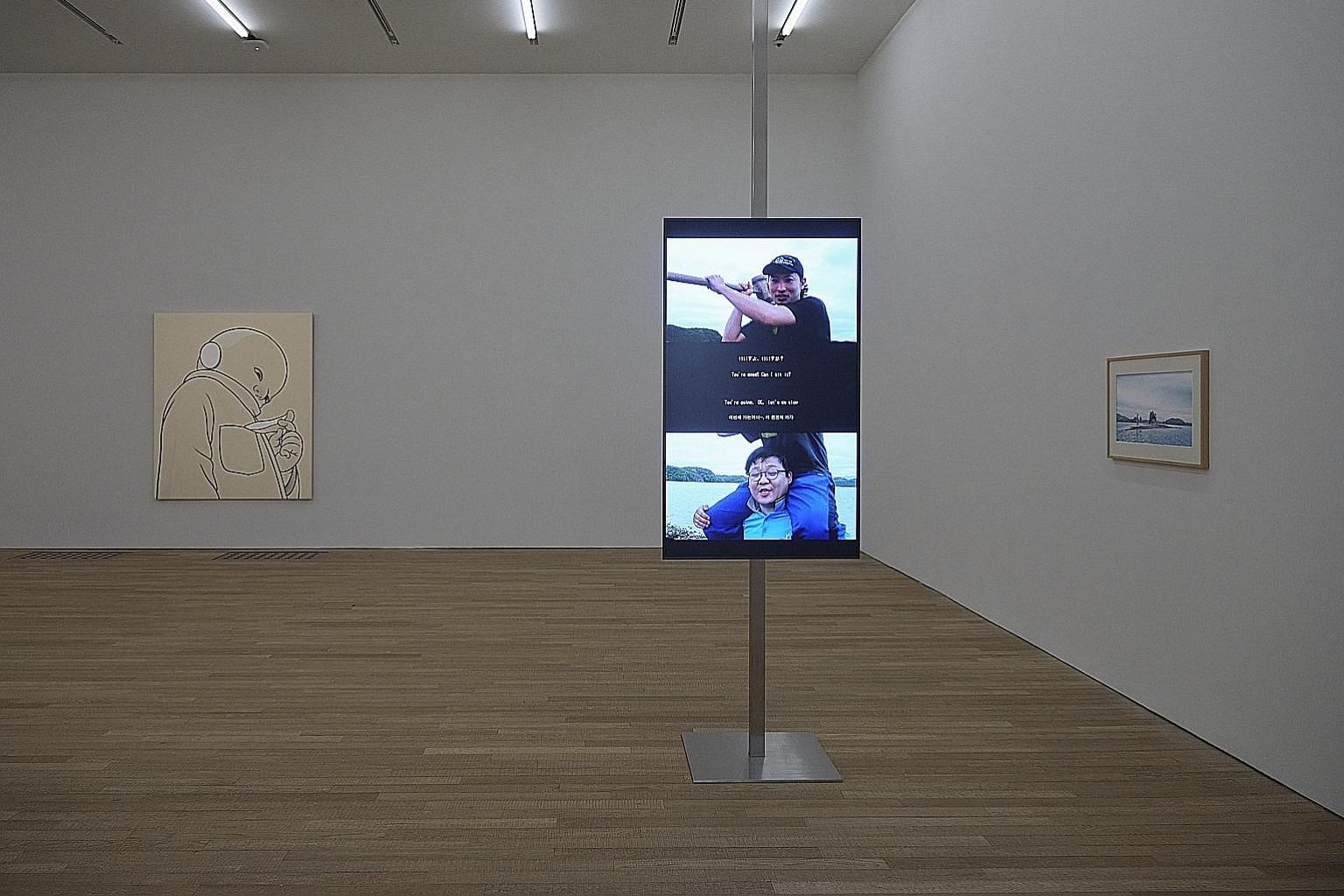 Works on show include They Do Not Understand Each Other (left) by Japanese artist Tsubasa Kato and Earth (above) by Singaporean artist Ho Tzu Nyen.