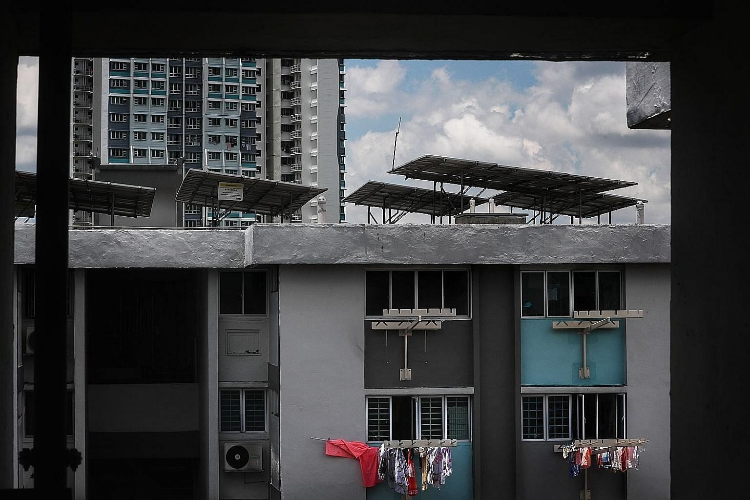 Solar panels on the rooftops of Housing Board blocks in Ang Mo Kio. The Government's green vision includes dramatically increasing solar energy generation and electric vehicle use, reducing household waste, making buildings much more energy-efficient