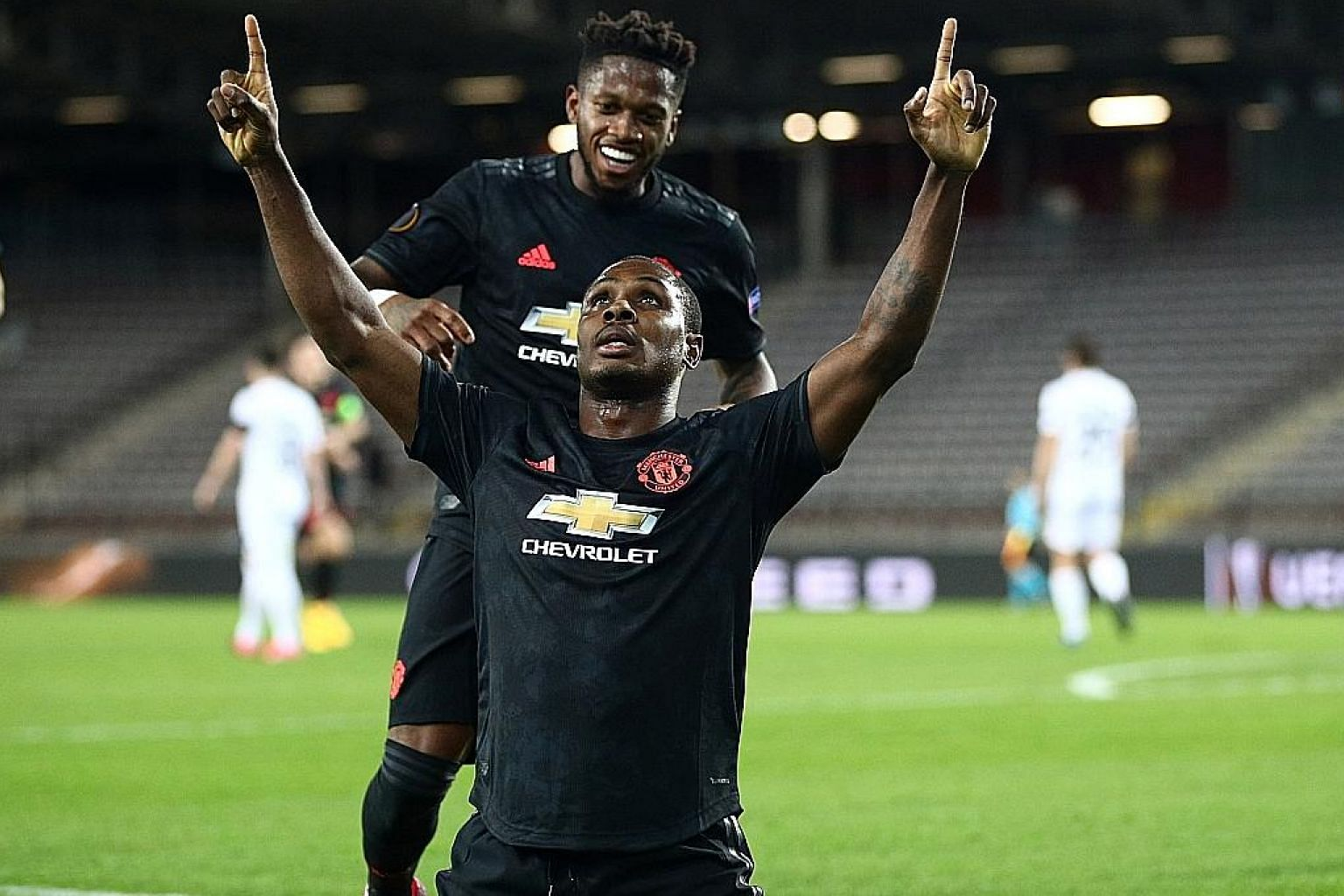 Brazilian Fred joins in the celebrations after Nigerian Odion Ighalo opens accounts for United in their 5-0 win in the first leg of their Europa League last-16 tie against Austria's Lask on March 12. It was United's last game before the coronavirus c