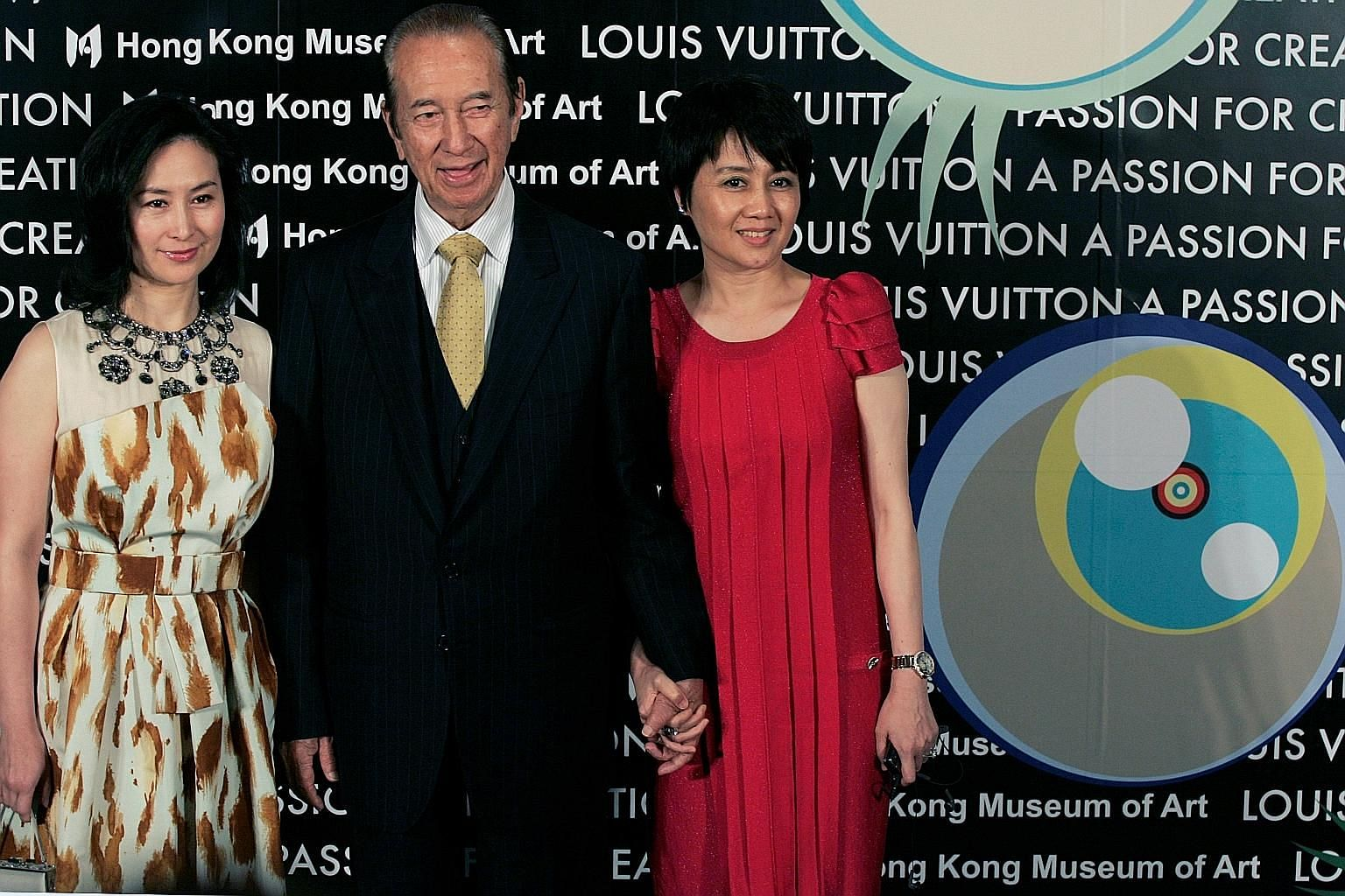 Macau gambling king Stanley Ho in 2009 with his daughter Pansy (left) and wife Angela Leong. The flamboyant tycoon, who loved to dance and advised his nearest and dearest to shun gambling, headed one of the world's most lucrative gaming businesses th