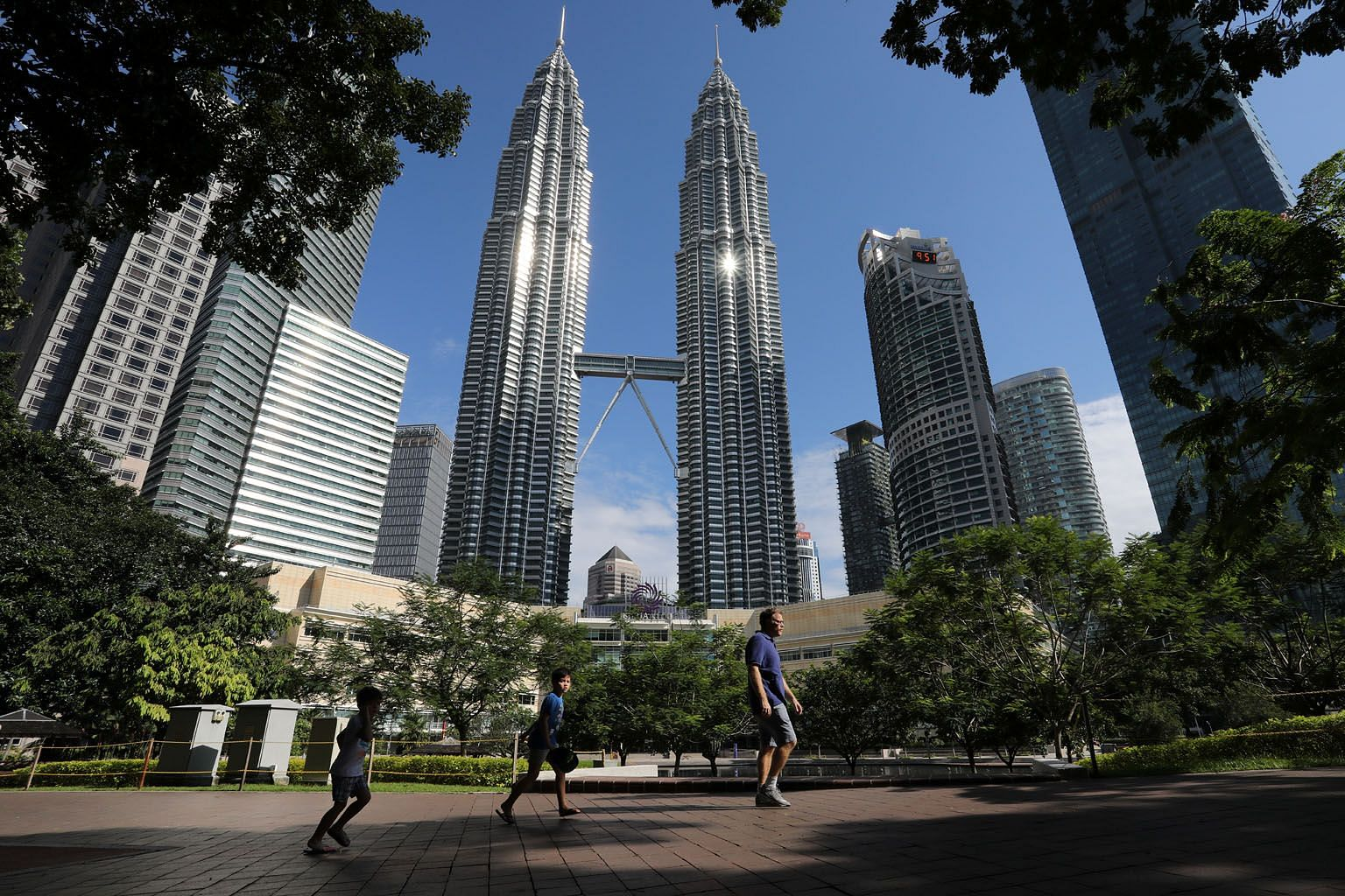 Wealthy Chinese investors are flocking to park their money in top-end property at home and overseas, including Kuala Lumpur (above) and Singapore, real estate agents say.
