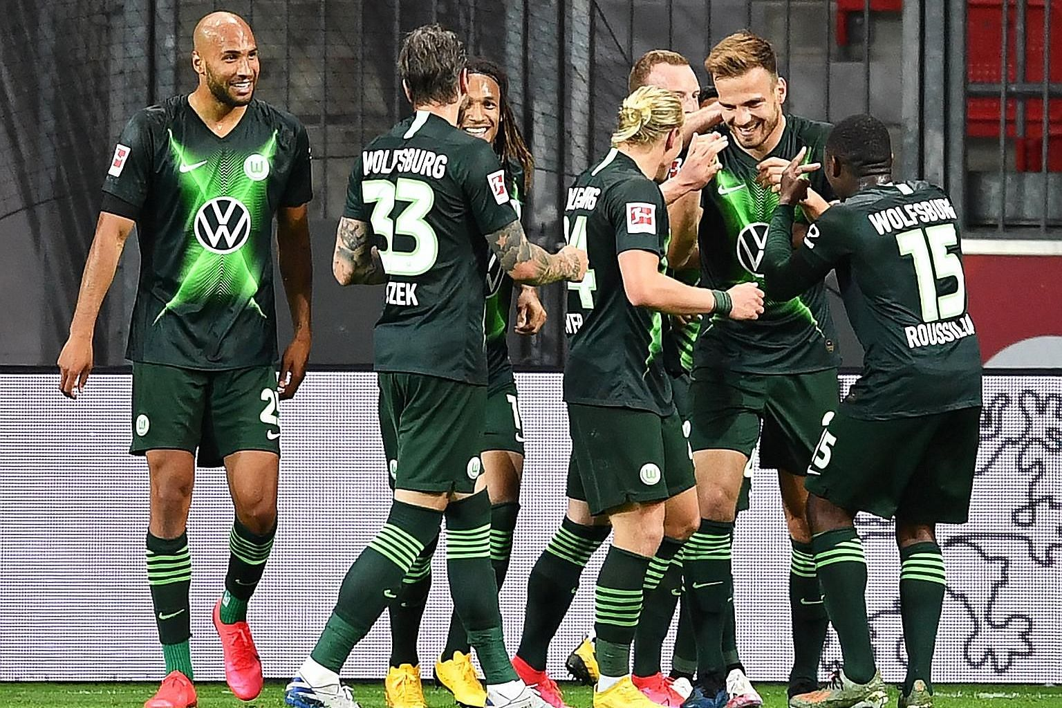 Marin Pongracic (second from right) is surrounded by teammates after putting Wolfsburg 4-0 up with his second goal against Leverkusen.