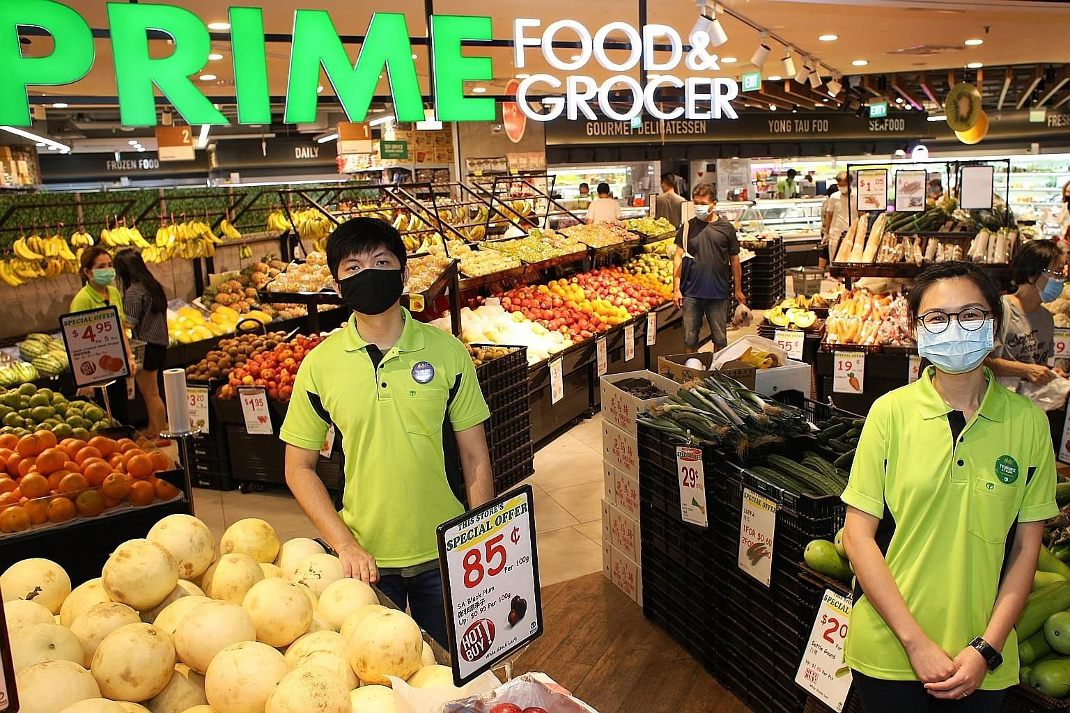 (From left) Retail assistants Niki Lim and Wendy Leong are working at Prime Food & Grocer supermarket in Century Square mall. Ms Leong, an air stewardess who was placed on furlough, applied through the virtual career fairs platform under Workforce Si