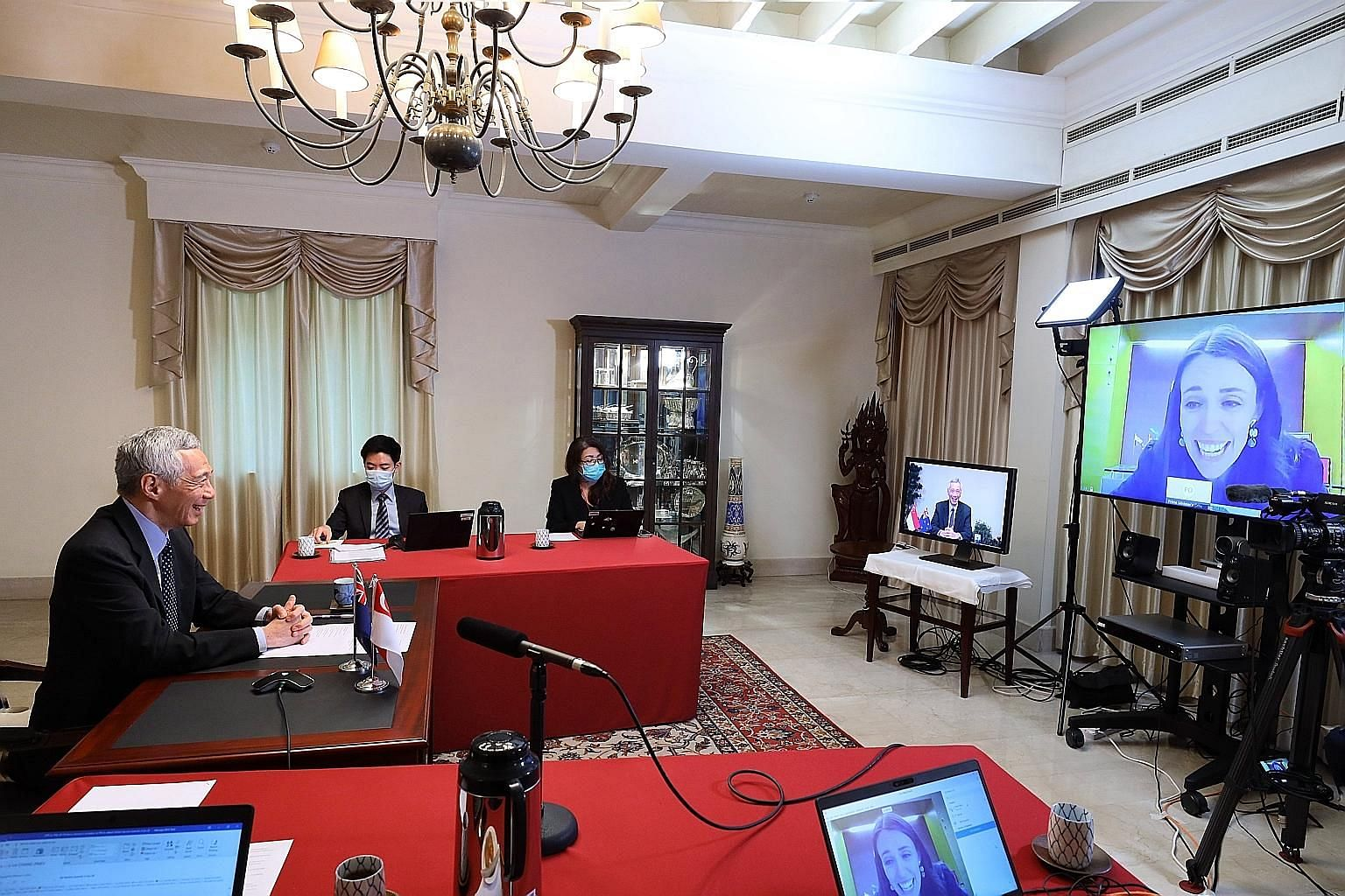 Prime Minister Lee Hsien Loong having a virtual meeting with New Zealand Premier Jacinda Ardern yesterday. PHOTO: MINISTRY OF COMMUNICATIONS AND INFORMATION
