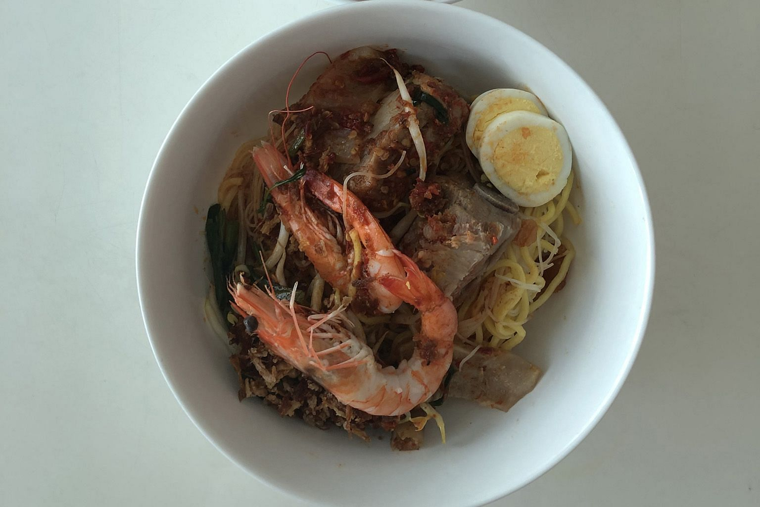 The 3 Combination Prawn Noodle comes with two crunchy and sweet mid-sized prawns.