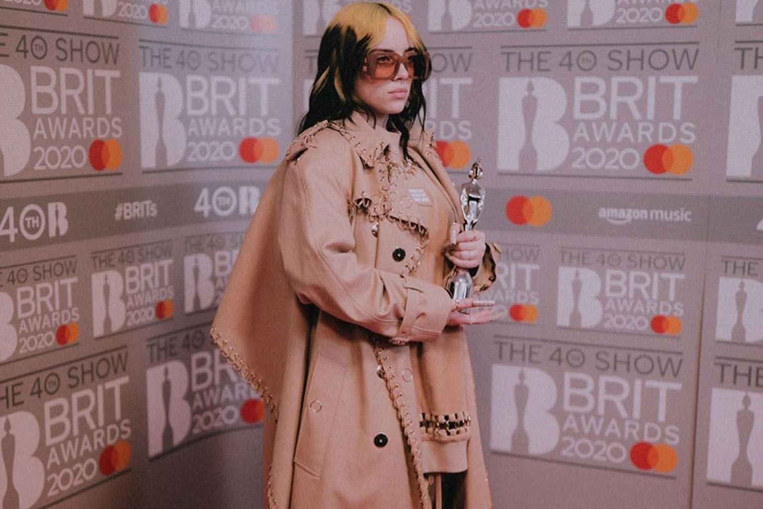 American singer Billie Eilish (above) has received praise and criticism for her fashion choices.