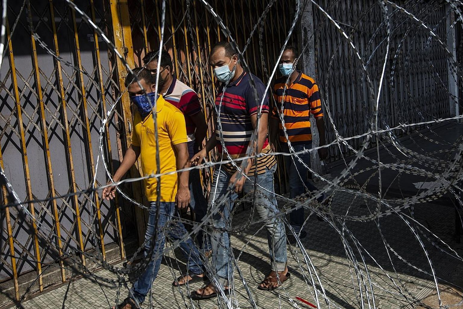 Migrant workers in a locked down area in Kuala Lumpur this month. Such workers in Malaysia are a risk group for Covid-19 infection.