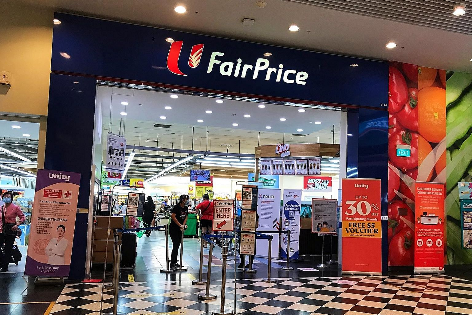 Jurong Point's FairPrice outlet (above) and Jurong West Market and Food Centre (left) at Block 505 Jurong West Street 52 are two spots which were recently visited by people who had tested positive for the coronavirus.