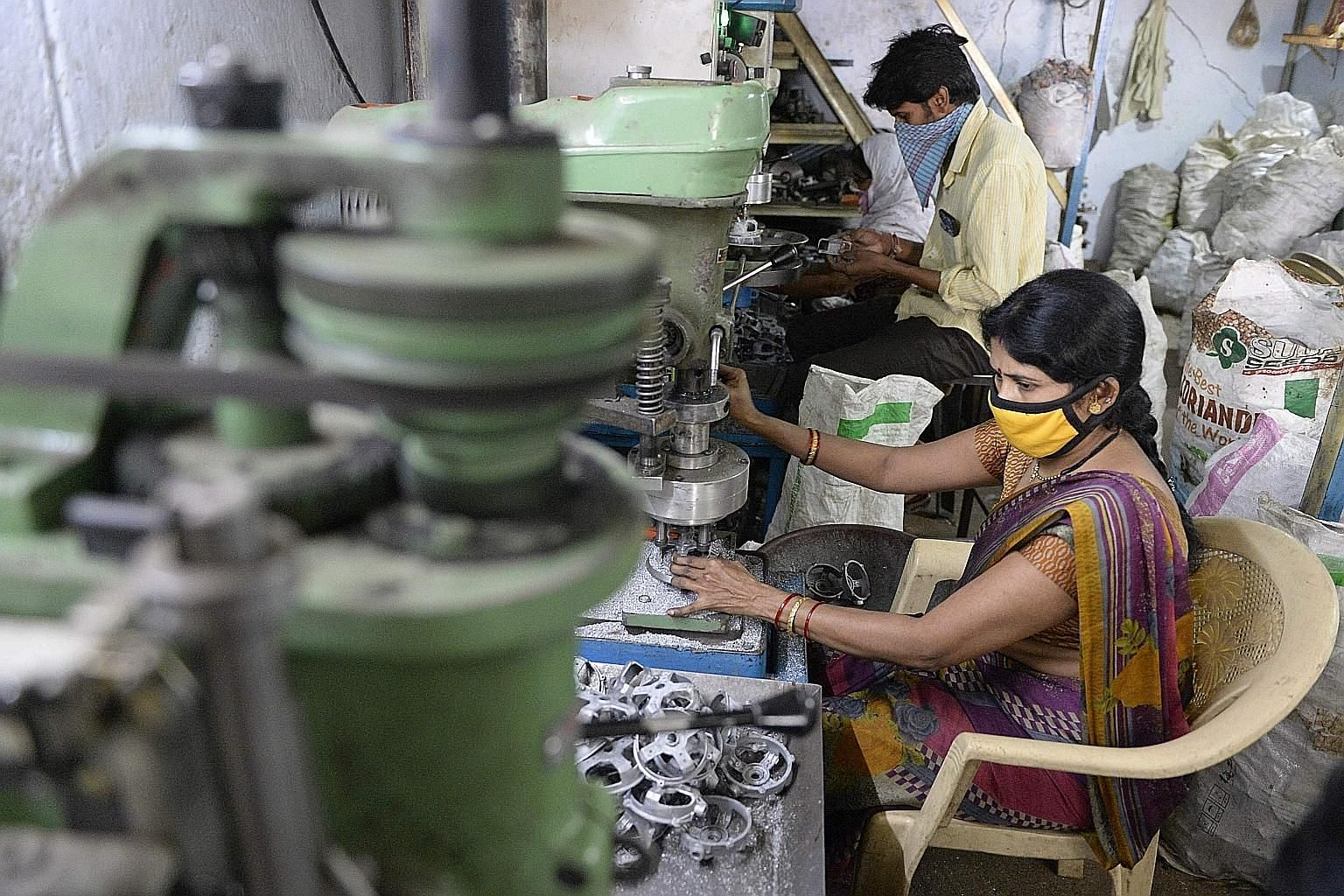 India has identified 12 sectors it can achieve self-reliance in. They include shoes, auto components, textiles, industrial machinery (above) and furniture, sectors which India wants to be global suppliers. But multiple labour laws, weak infrastructur
