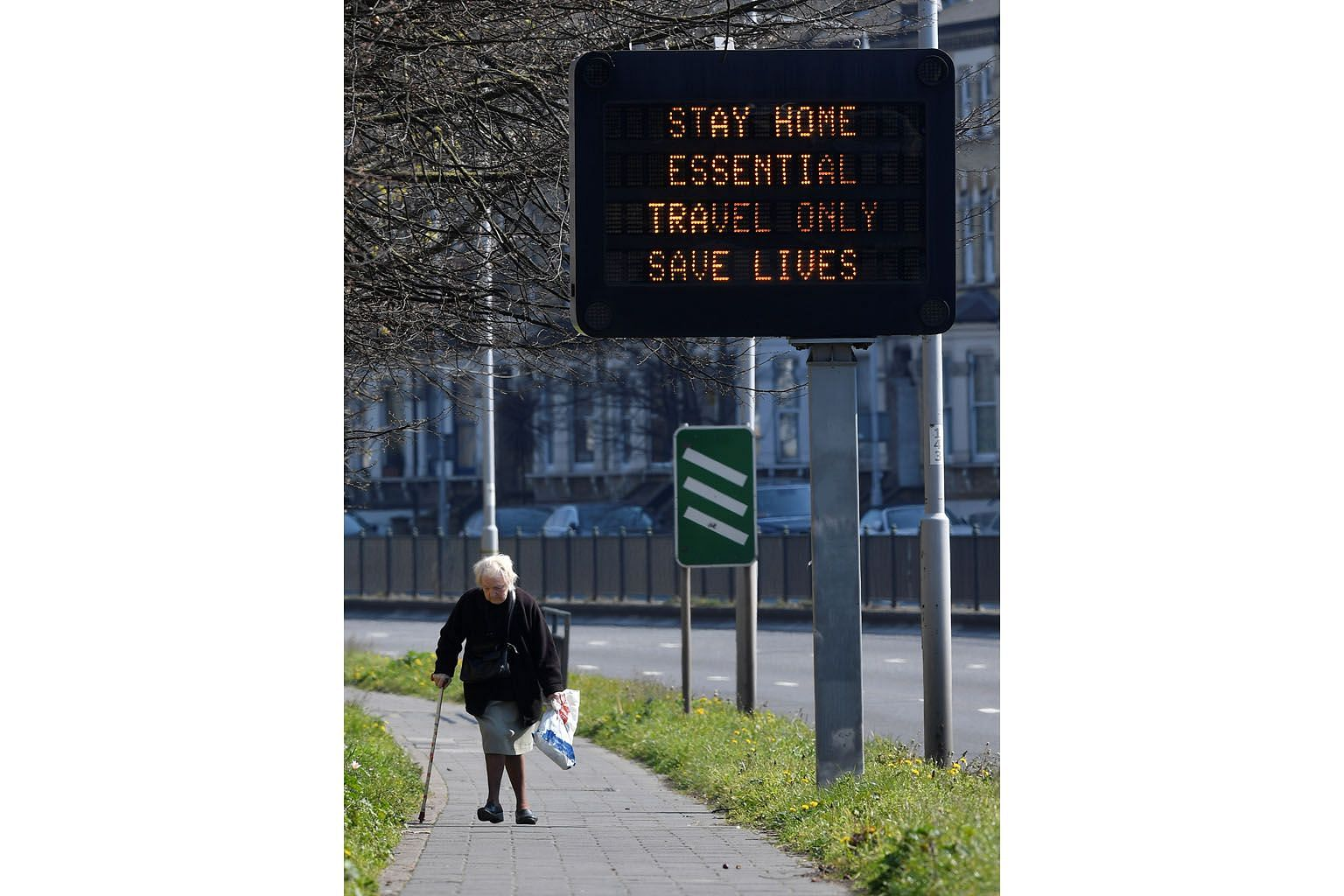 """A public information message on a traffic sign by the A4 road in West London as the spread of Covid-19 continues in Britain. In the United Kingdom, the government advised particularly strict social distancing for the over-70s, """"regardless of medical"""