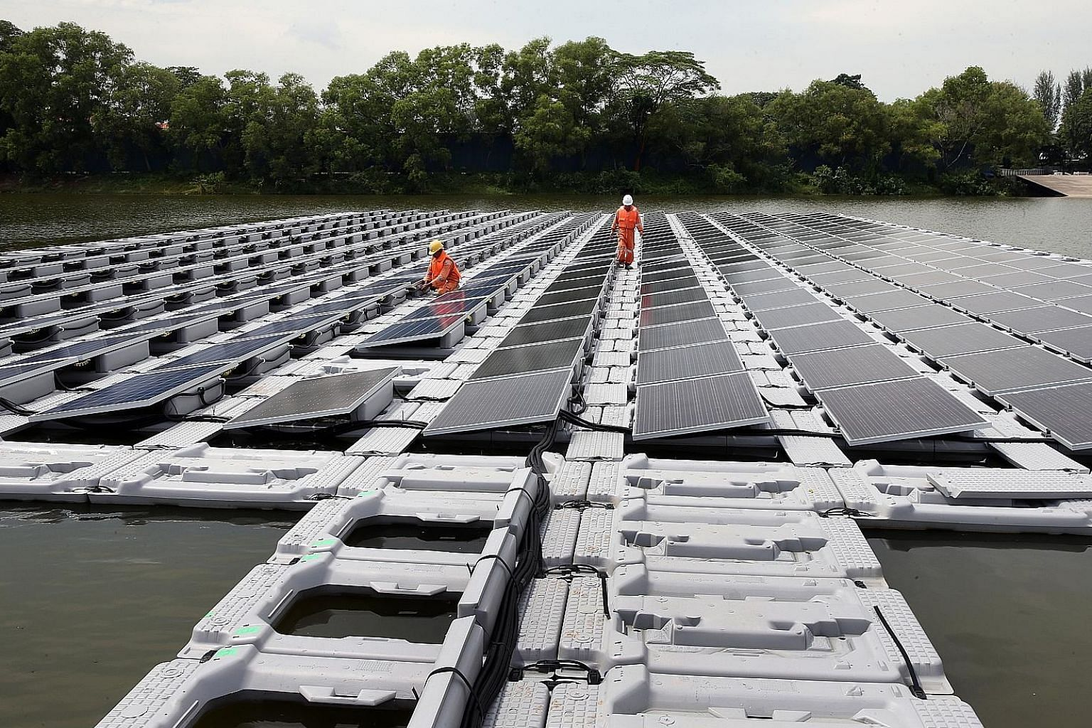 A 2016 photo showing a floating solar photo-voltaic cell test-bed in Tengeh Reservoir in Tuas. Singapore has pledged to peak emissions at 65 million tonnes of carbon dioxide equivalent around 2030.