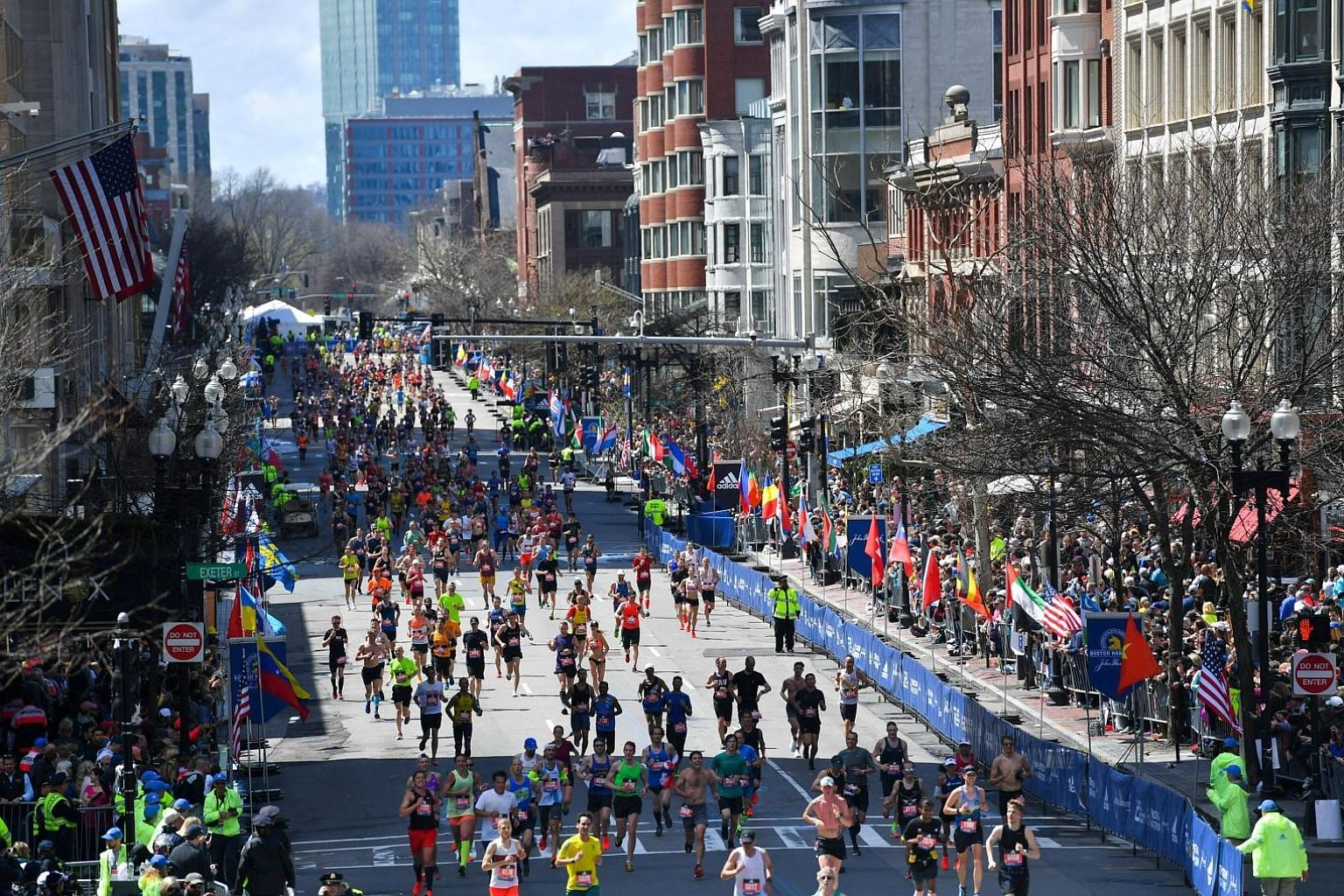 Runners approach the finish line on Boylston Street during the 123rd Boston Marathon on April 15 last year.