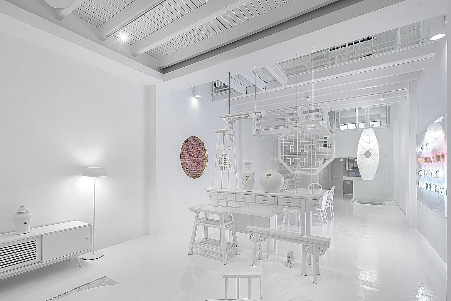 To more intentionally capture and reveal history, Mr Colin Seah of Ministry of Design painted Figment's restored shophouse in Blair Road almost entirely white. He left playful peek-a-boo vignettes on decor items such as vintage ceramic plates hung on the