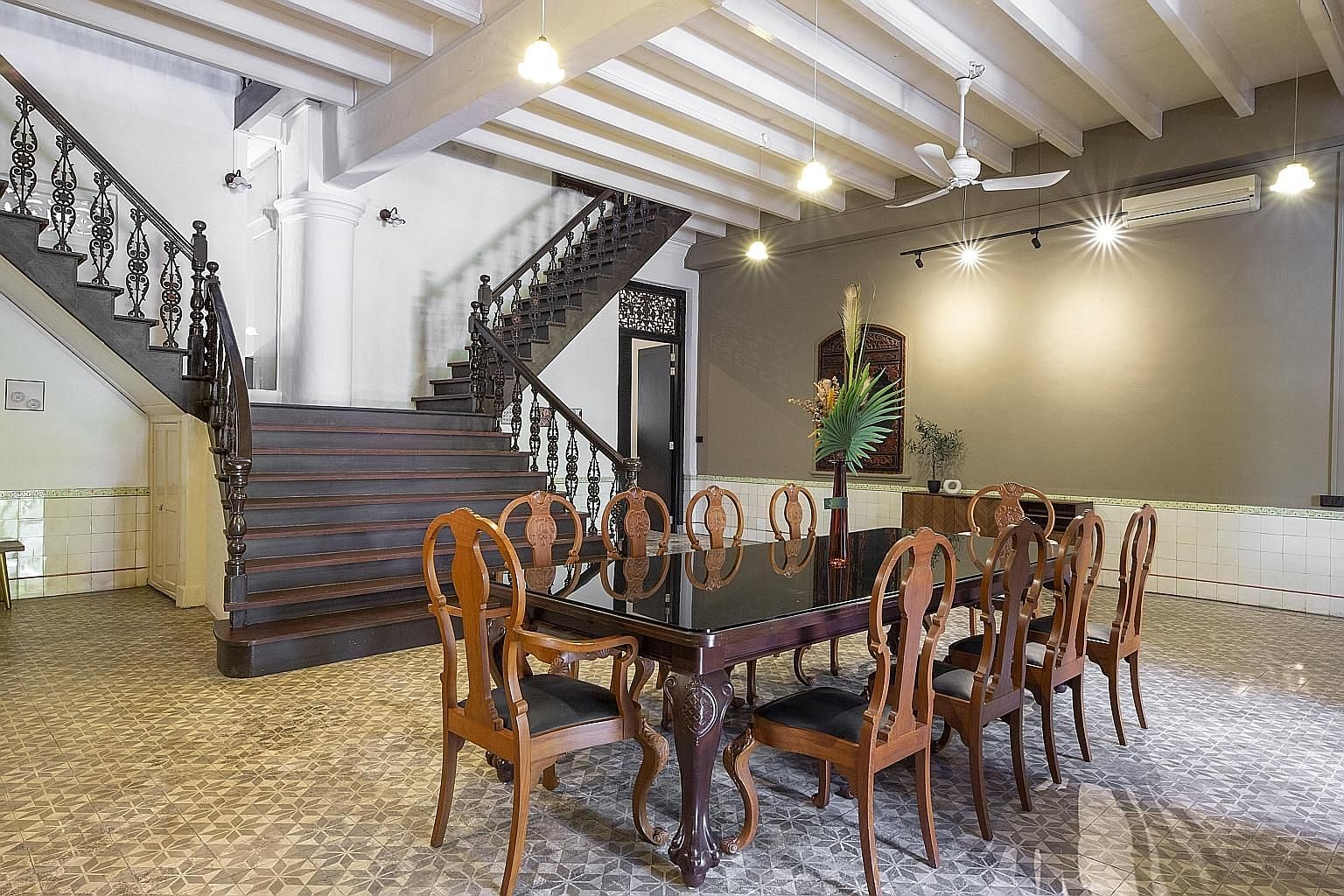Dining lounge at Emerald Hill in clear view of the grand staircase. The interior and accents reflect the neighbourhood's distinctive Peranakan history.