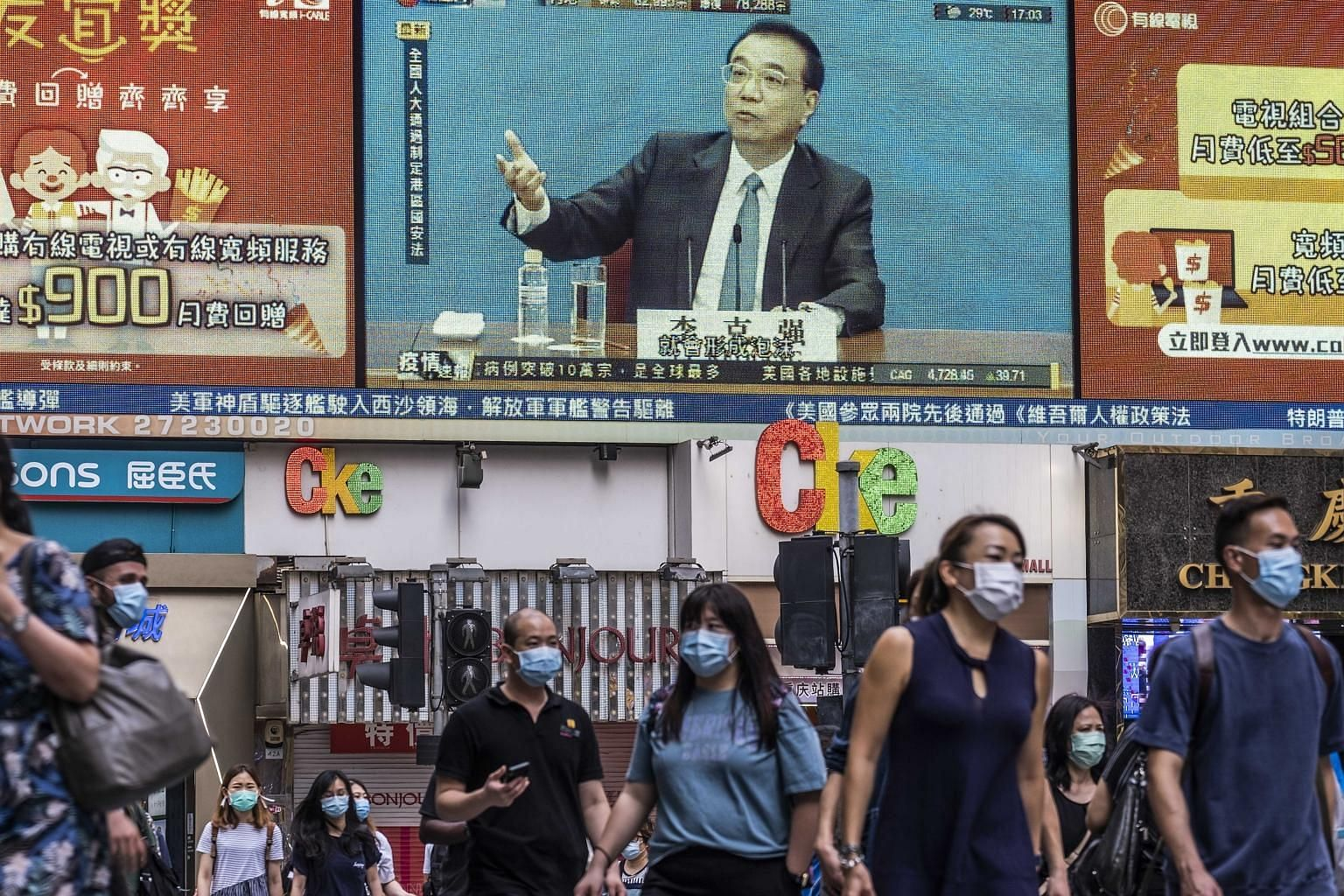 Chinese premier Li Keqiang, seen speaking on an outdoor video screen in Hong Kong on Thursday. The emergence of China's national security Bill and the United States response that it can no longer certify Hong Kong's political autonomy is stoking conc