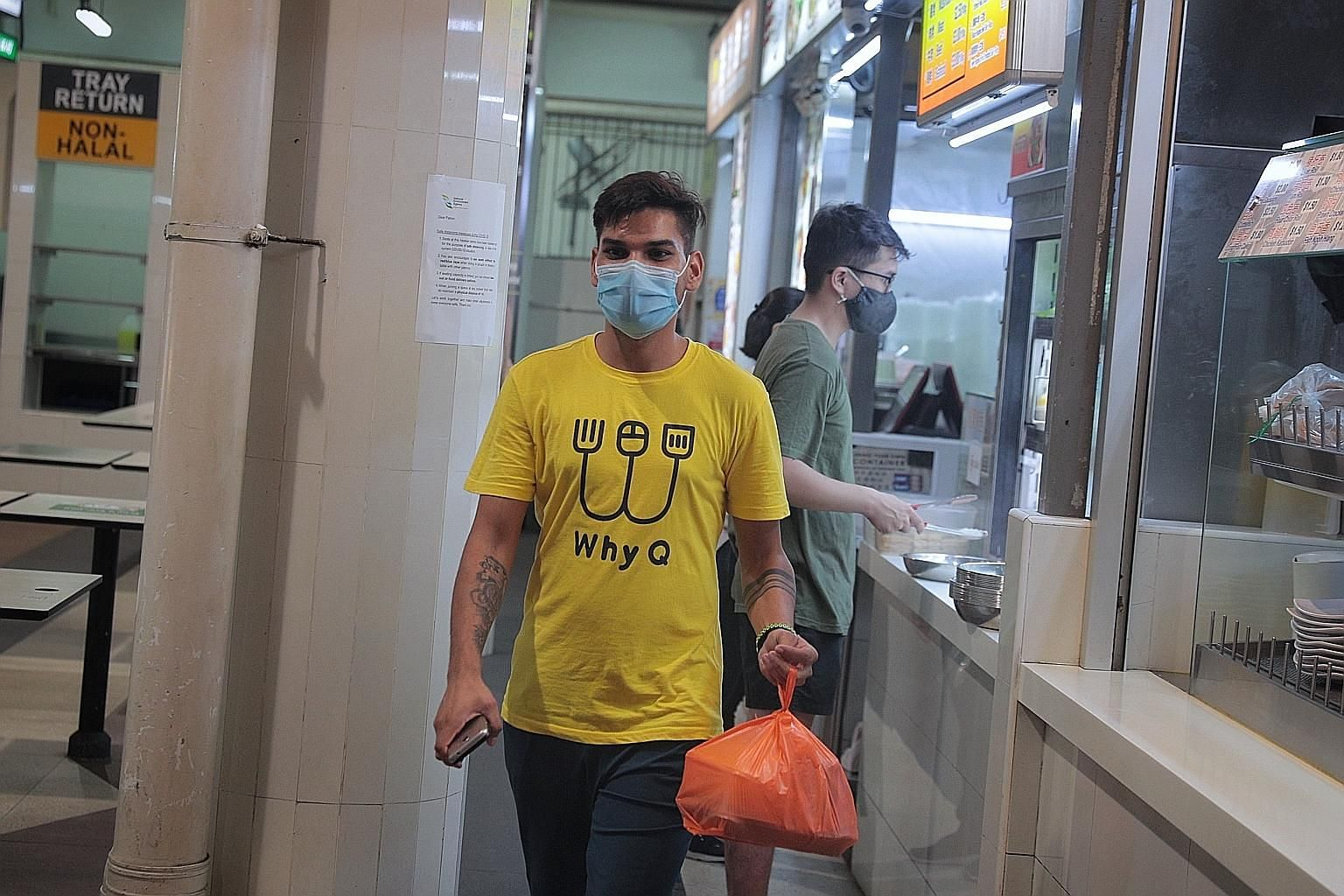 A WhyQ employee with food collected from a stall in Bukit Panjang for delivery yesterday. The new Marketplace@WhyQ, unlike other delivery platforms, will charge its operators no commission or start-up fees.
