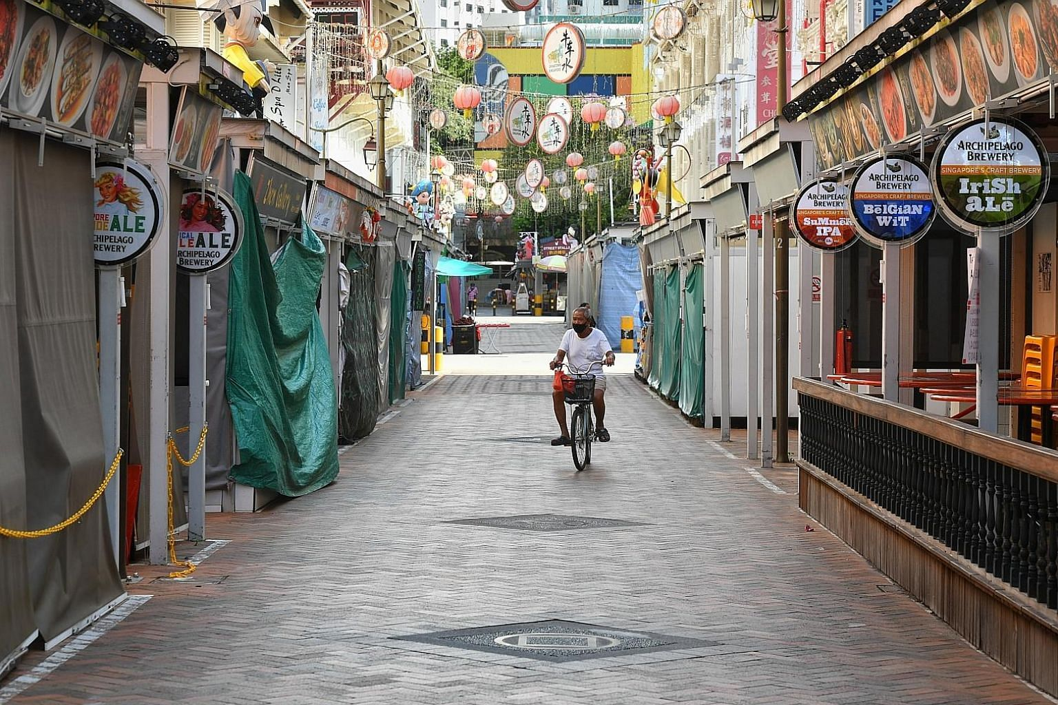 An almost-empty Terengganu Street in Chinatown on May 14. Many wish for a sharp, V-shaped recovery in the global economy after the steep decline in the first quarter. However, this is possible only if there is an effective treatment, or the Covid-19