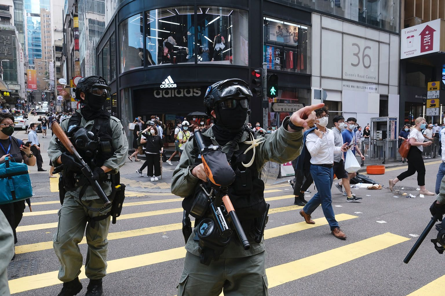 Riot police armed with pepper ball rifles in the Central district during a protest in Hong Kong on Wednesday. Officers fired pepper spray projectiles as protesters hit the streets to oppose China's increasing control over the city - a return to the s