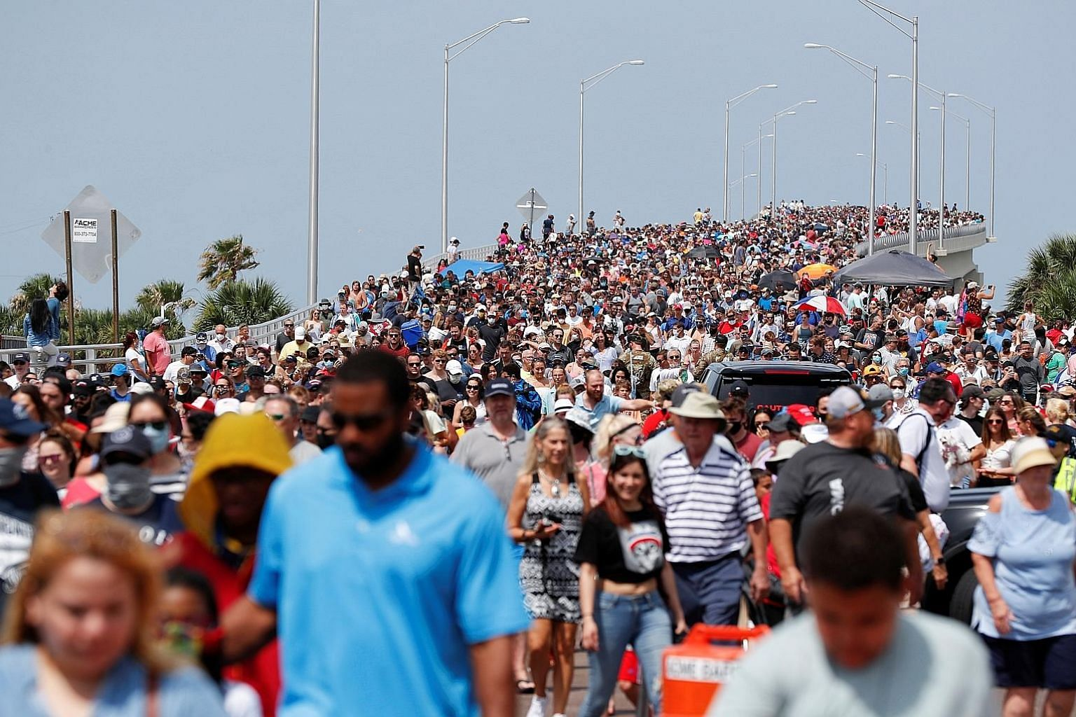 People gathering to watch the launch of the SpaceX Falcon 9 rocket carrying the Crew Dragon capsule in Cape Canaveral, Florida, on Saturday.