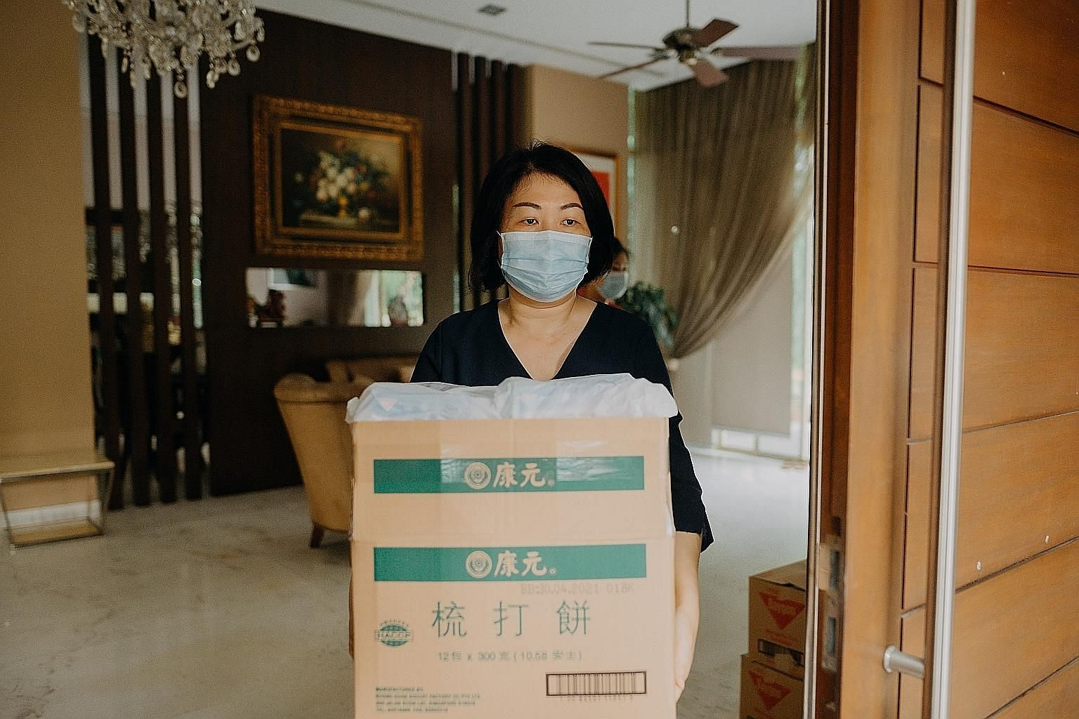 Volunteer Annie Gan helped to pack items for migrant workers who have been tested for the coronavirus and have been given the all-clear before they moved into temporary accommodation in Kismis Avenue.