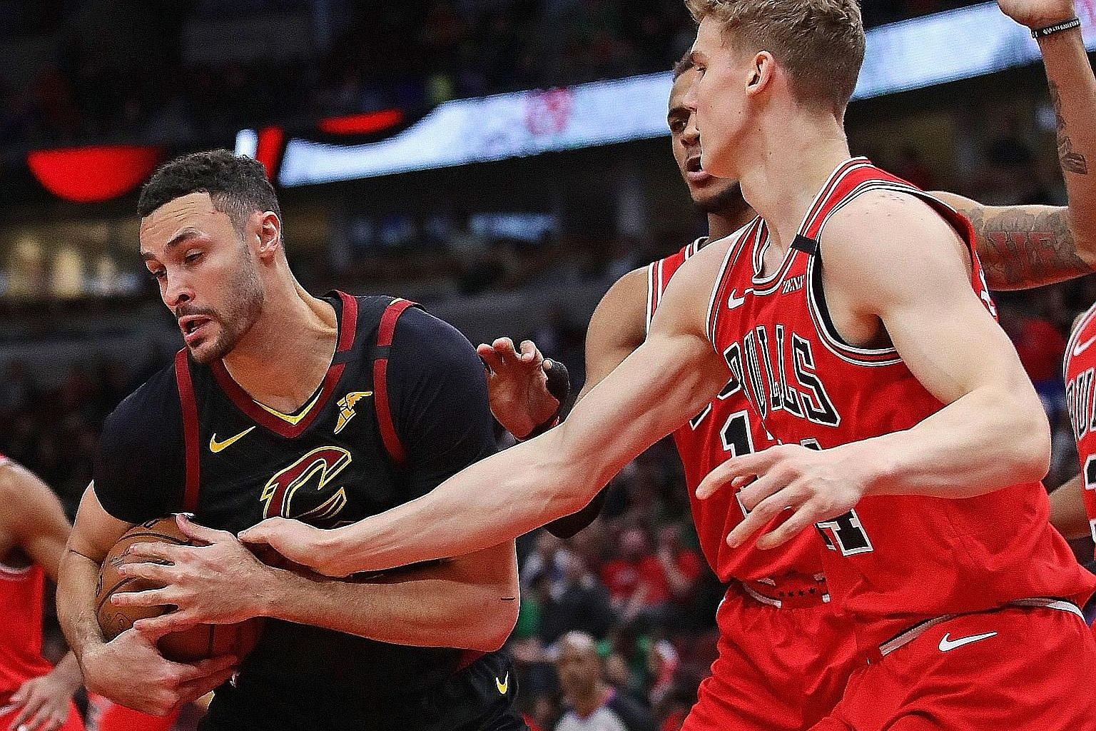 "Cleveland's Larry Nance Jr trying to keep the ball away from Lauri Markkanen of the Chicago Bulls at the United Centre on March 10, a day before the NBA suspended its season. The Cavaliers forward, 27, is ""scared"" of making an NBA comeback during the coro"
