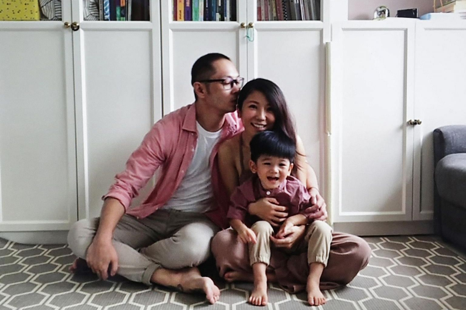 Commercial photographer and film director Nicky Loh and his wife Vivi, with their two-year-old son Nathan. This photograph was shot during a Zoom call. ST PHOTO: NEO XIAOBIN