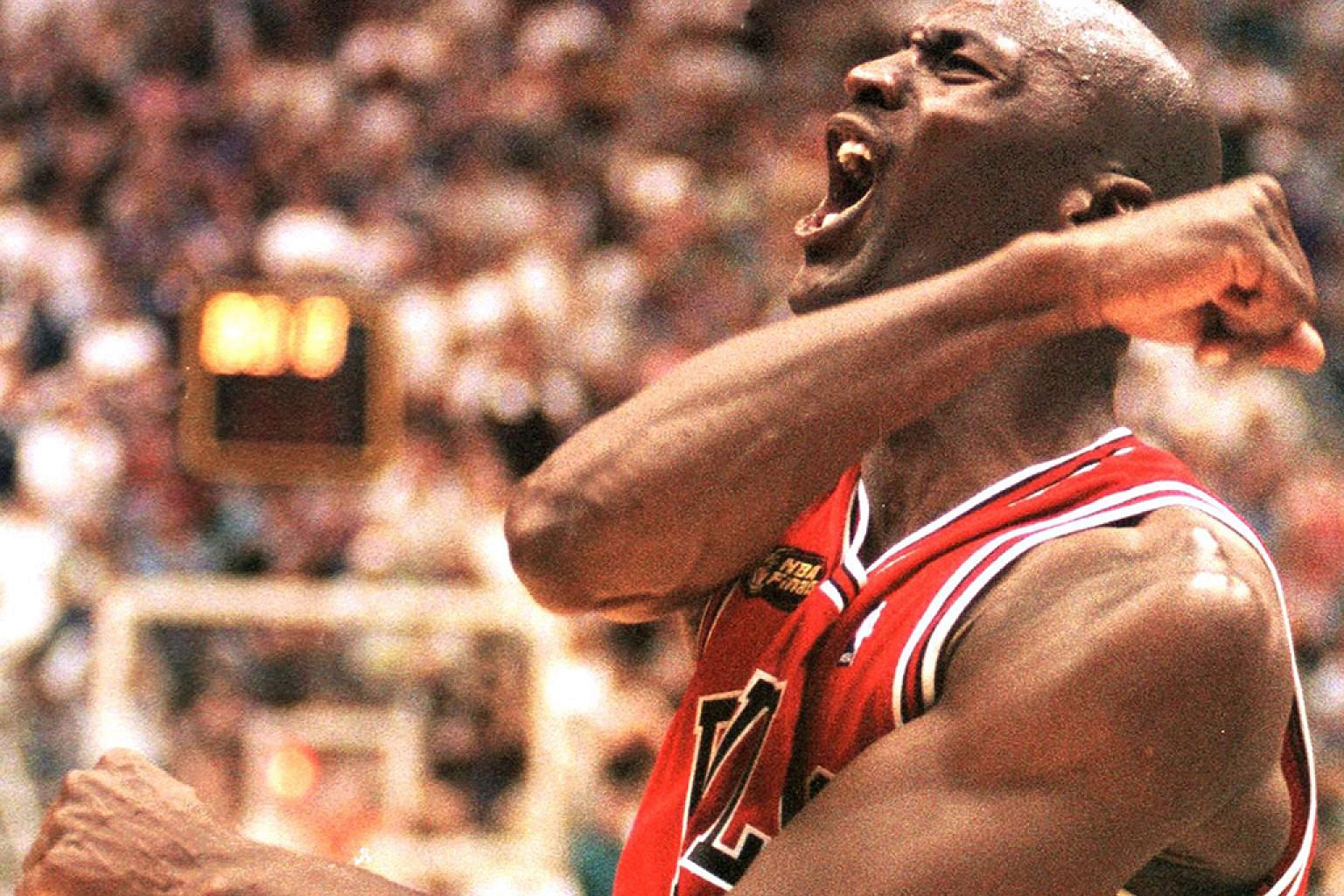 Michael Jordan of the Chicago Bulls celebrating after winning Game Six of the 1998 NBA Finals against the Jazz at the Delta Centre in Utah. He sank the winning jumper to give the Bulls a 87-86 victory and their sixth NBA title.