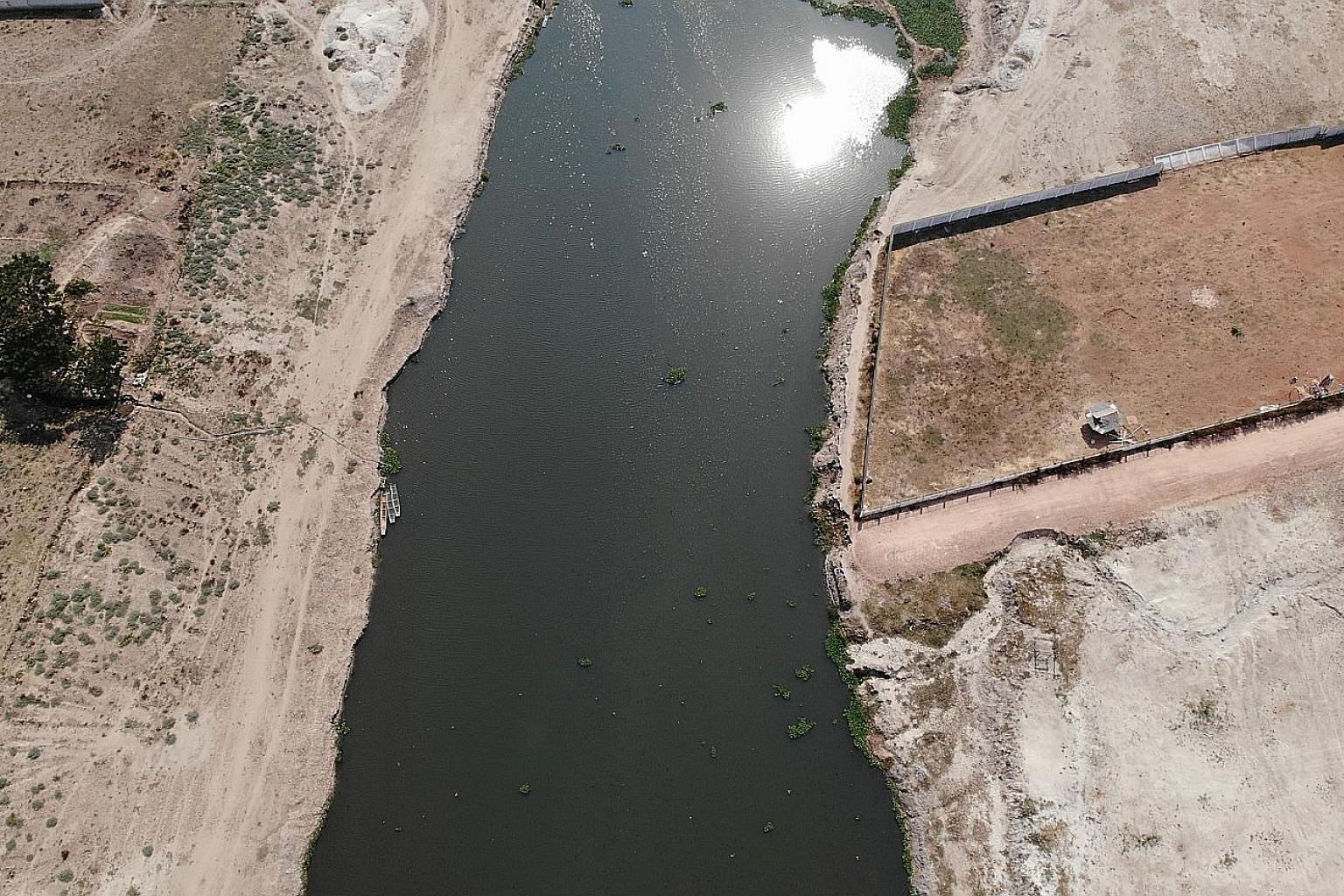 An aerial shot of a Mekong tributary outside Vientiane, Laos, where tests on a drone survey of plastic trash were done. Microplastics were also found to be abundant in the Mekong and Ganges rivers.