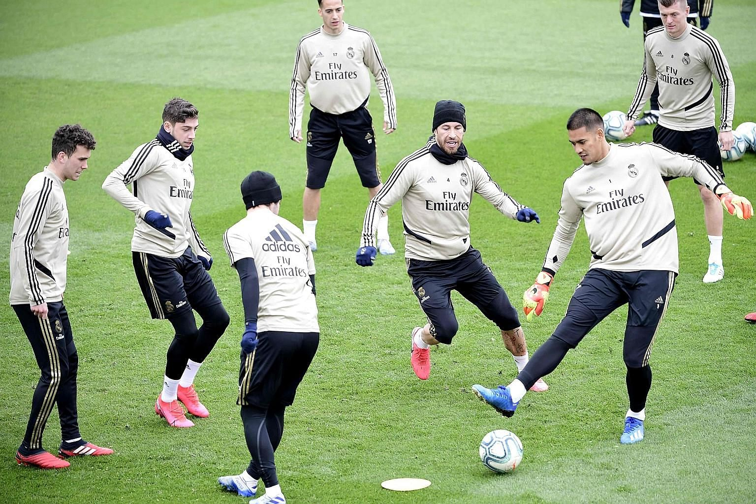 Real Madrid players, led by captain Sergio Ramos (third from right) training at their Estadio Alfredo di Stefano training centre, where they will play their six remaining home league games while the Santiago Bernabeu is being renovated. They are two