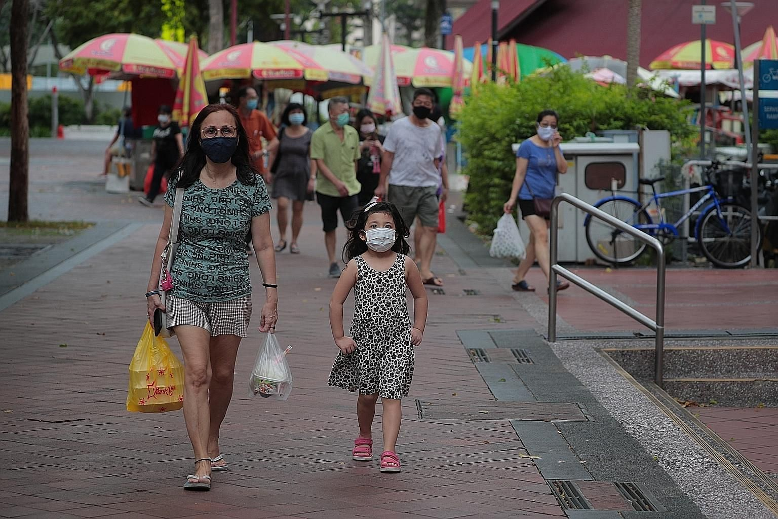 The task force tackling the Covid-19 outbreak has decided that face shields are not as effective as masks in reducing the risk of virus transmission, said Health Minister Gan Kim Yong. ST PHOTO: JASON QUAH
