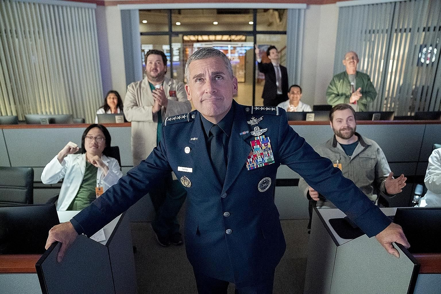 Jimmy O. Yang (far left) and Steve Carell (foreground) star in workplace comedy Space Force.