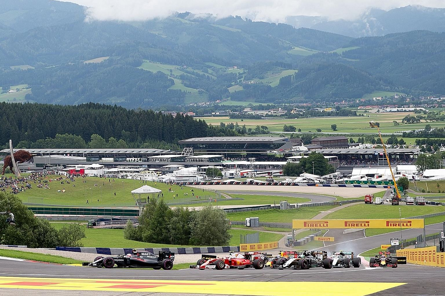 The pack going round Turn 2 after the start of last year's Austrian Grand Prix in Spielberg. Dutchman Max Verstappen has won for Red Bull at their home race in the past two years and will have the chance to make it a double next month. The circuit wi