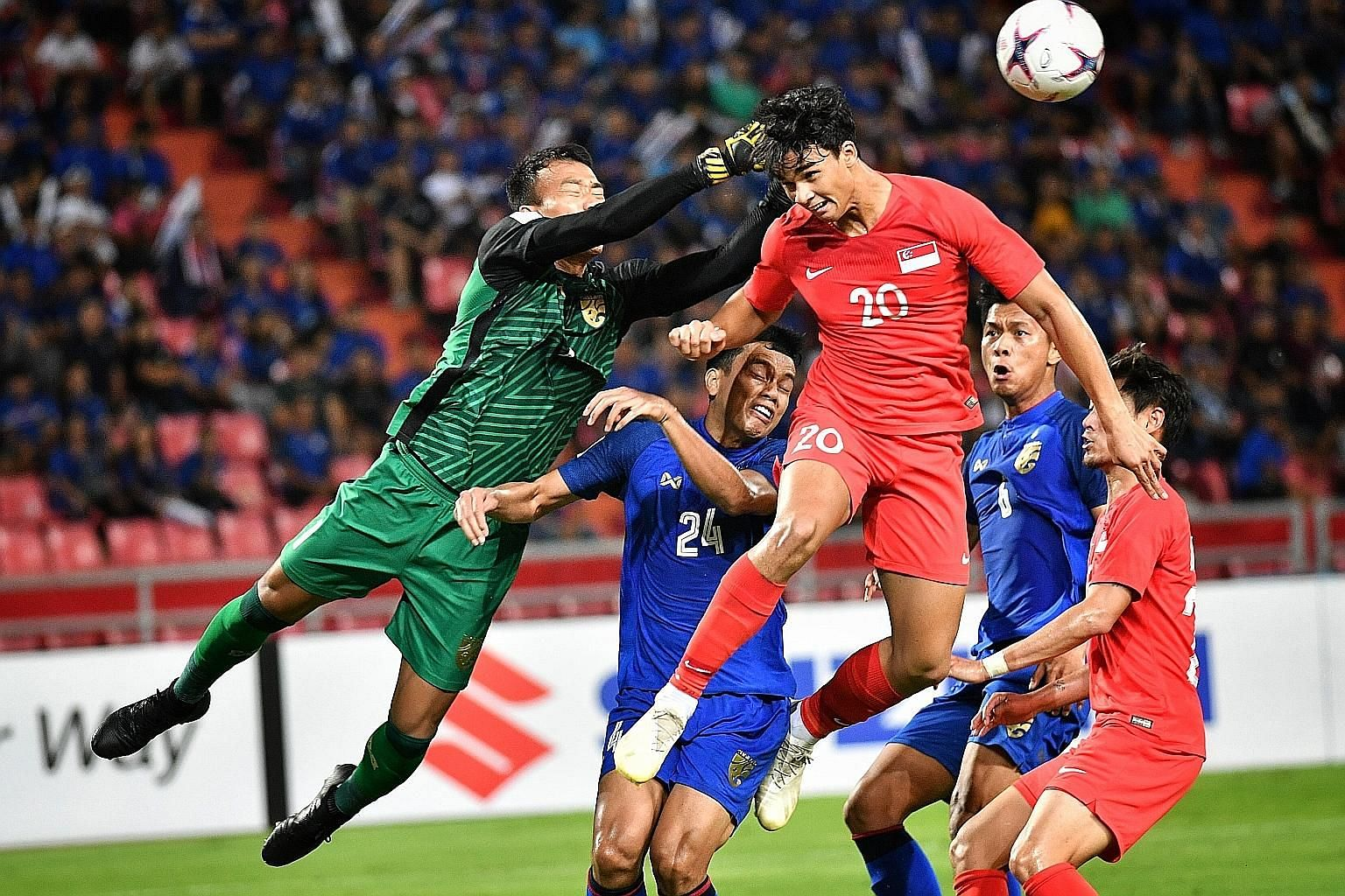 Thailand goalkeeper Chatchai Budprom thwarting Ikhsan Fandi's attempt at goal in a group game at the last AFF Suzuki Cup in Bangkok. Singapore lost 3-0.