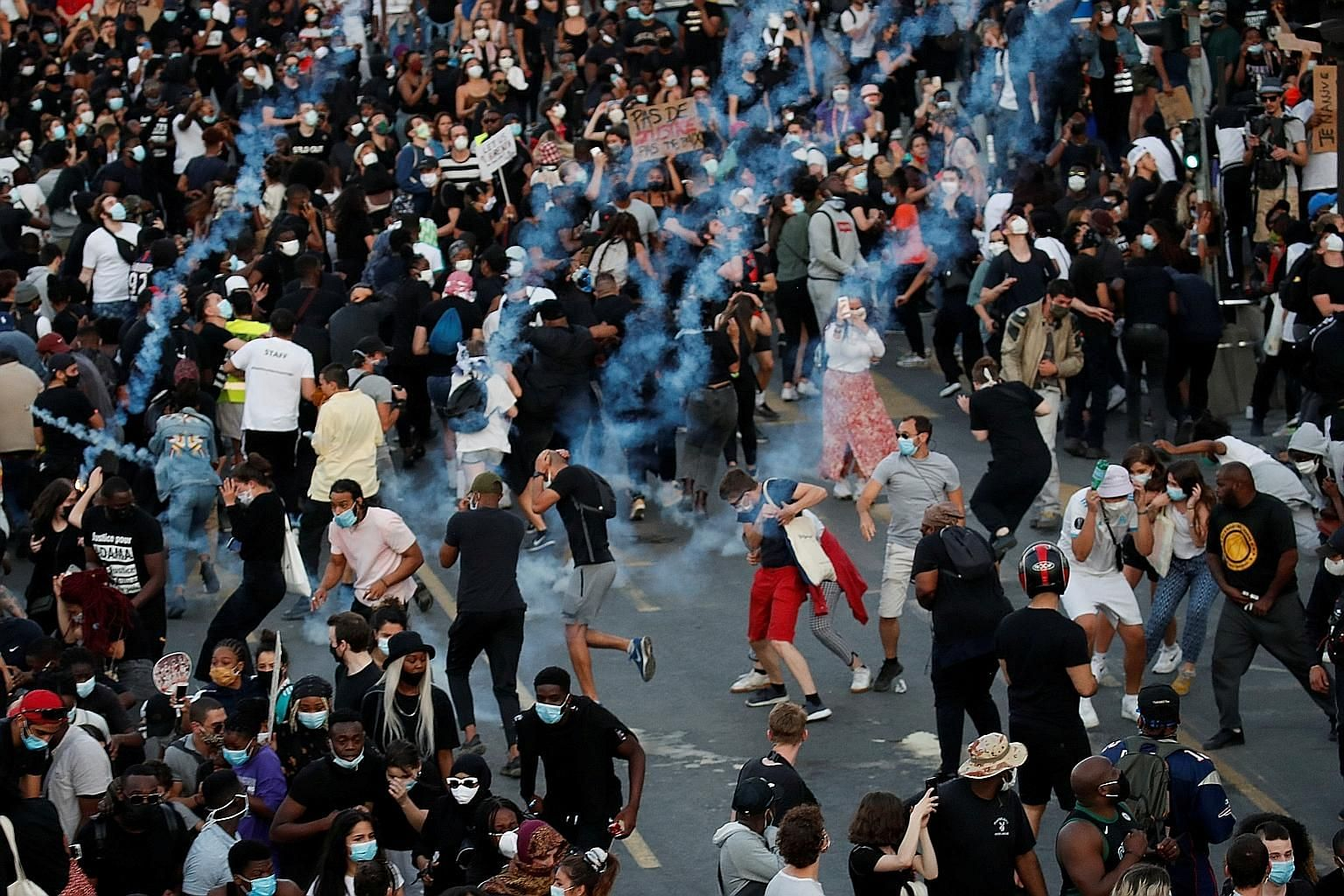 Clashes broke out between police and protesters in Paris on Tuesday after some 20,000 people rallied over the 2016 death of Mr Adama Traore, a black man, in police custody. Many were riled up by protests in the United States against police brutality