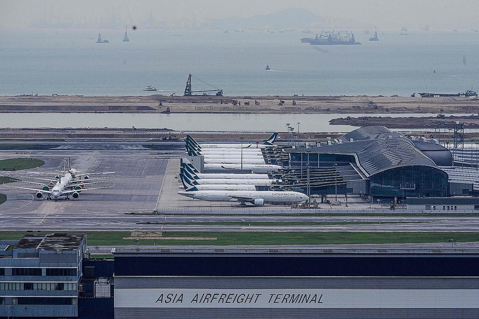 Cathay Pacific passenger jets parked at Hong Kong International Airport. Extreme weather conditions pose a larger-than-usual risk as many grounded planes are now grouped together at airports. PHOTO: AGENCE FRANCE-PRESSE