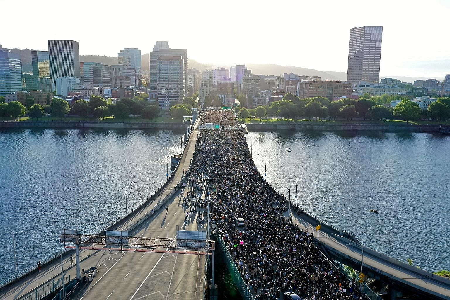 Protesters crossing Morrison Bridge in Portland, United States, on Wednesday, while rallying against the death of Mr George Floyd. PHOTO: REUTERS