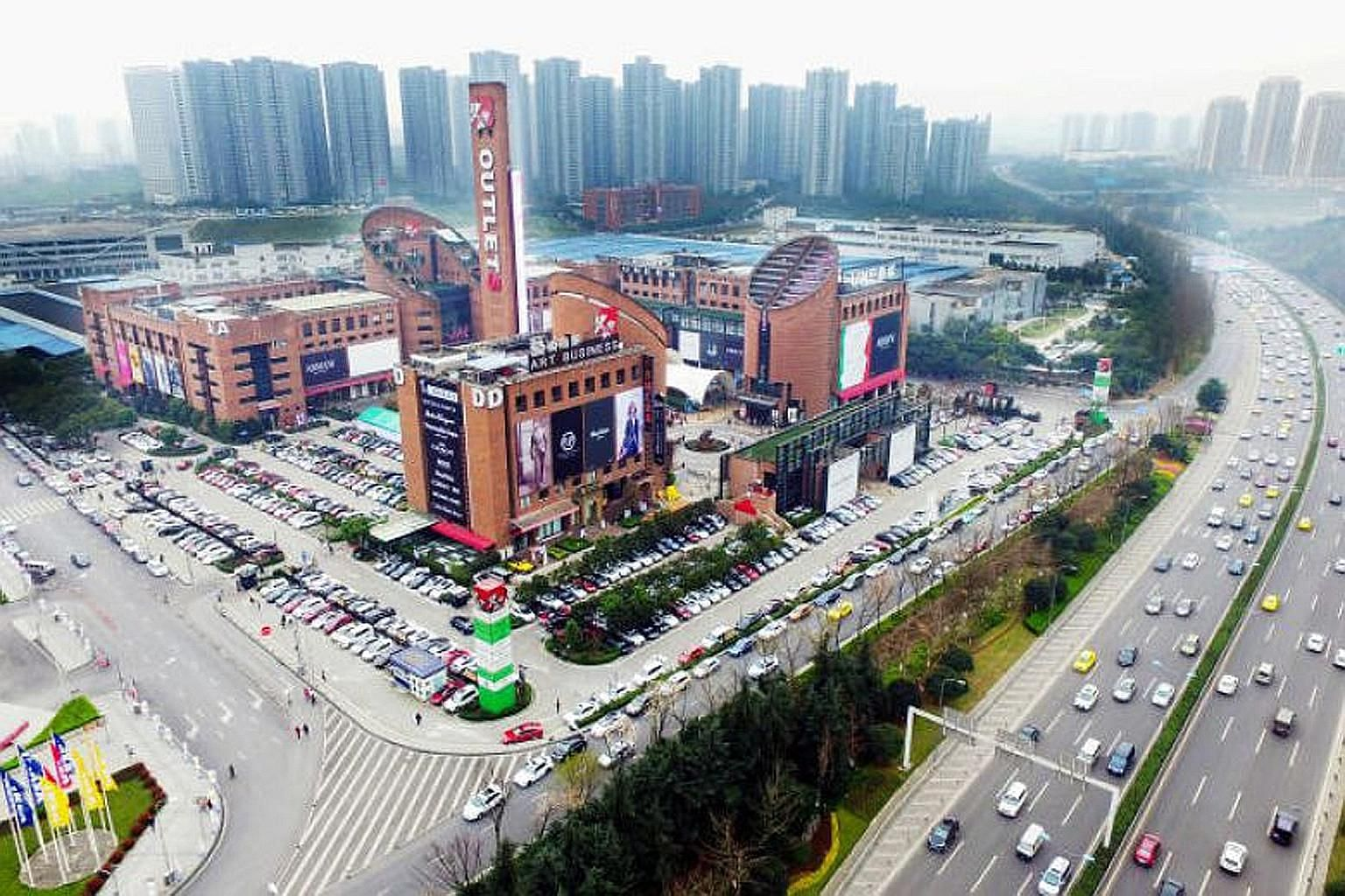 An outlet mall in Chongqing, China, that is part of Sasseur Reit's portfolio. Tenants of the Reit's properties in China share about 15 per cent of their revenue with its Chinese parent, which keeps some to run the properties, and shares a fixed sum a