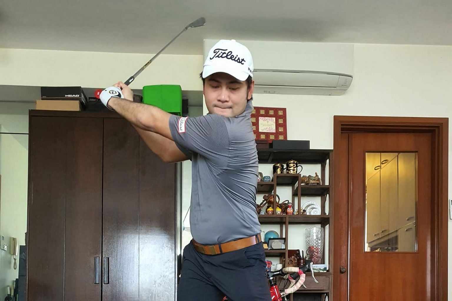 Stuck at home with the golf tour on hold and courses closed, Koh Dengshan practised his swing with a foam ball and exercised almost every day using his stationary bicycle and TRX resistance bands.