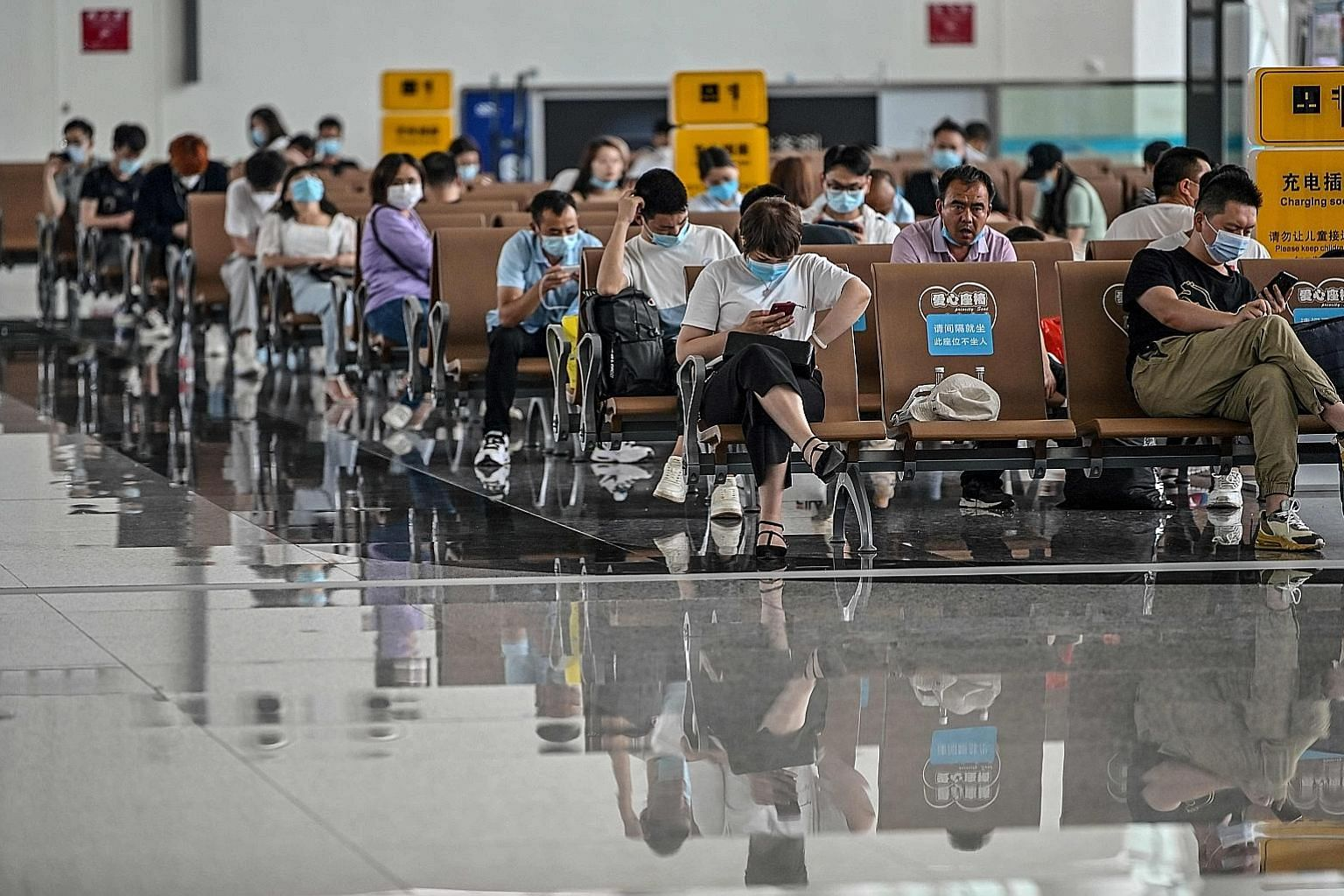 Passengers waiting at Wuhan's Tianhe Airport last week. Chinese citizens can return home, but borders are still closed to foreigners.