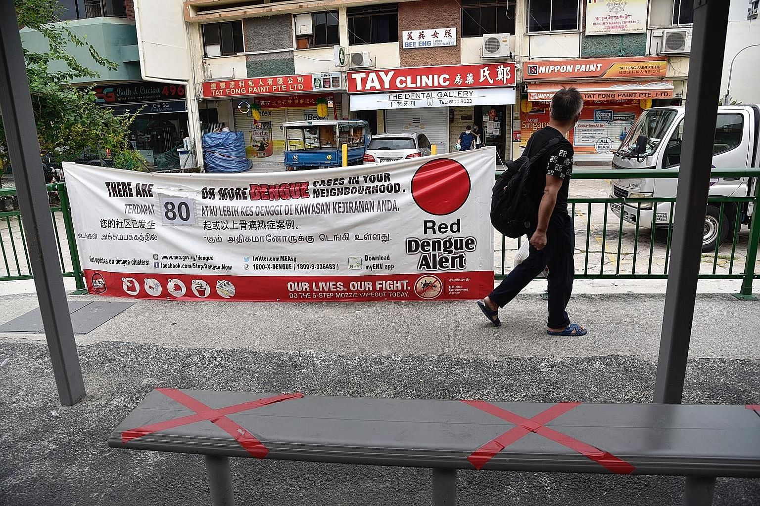 A banner in Geylang Road highlighting the number of dengue cases in the neighbourhood last month. Five times the number of mosquito larvae breeding spots were found in homes and common corridors during the circuit breaker months of April and May, com
