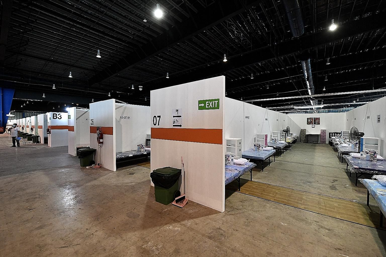 Fit-out works for community isolation facilities such as Changi Exhibition Centre (left) are contracted through the emergency procurement procedure. ST FILE PHOTO