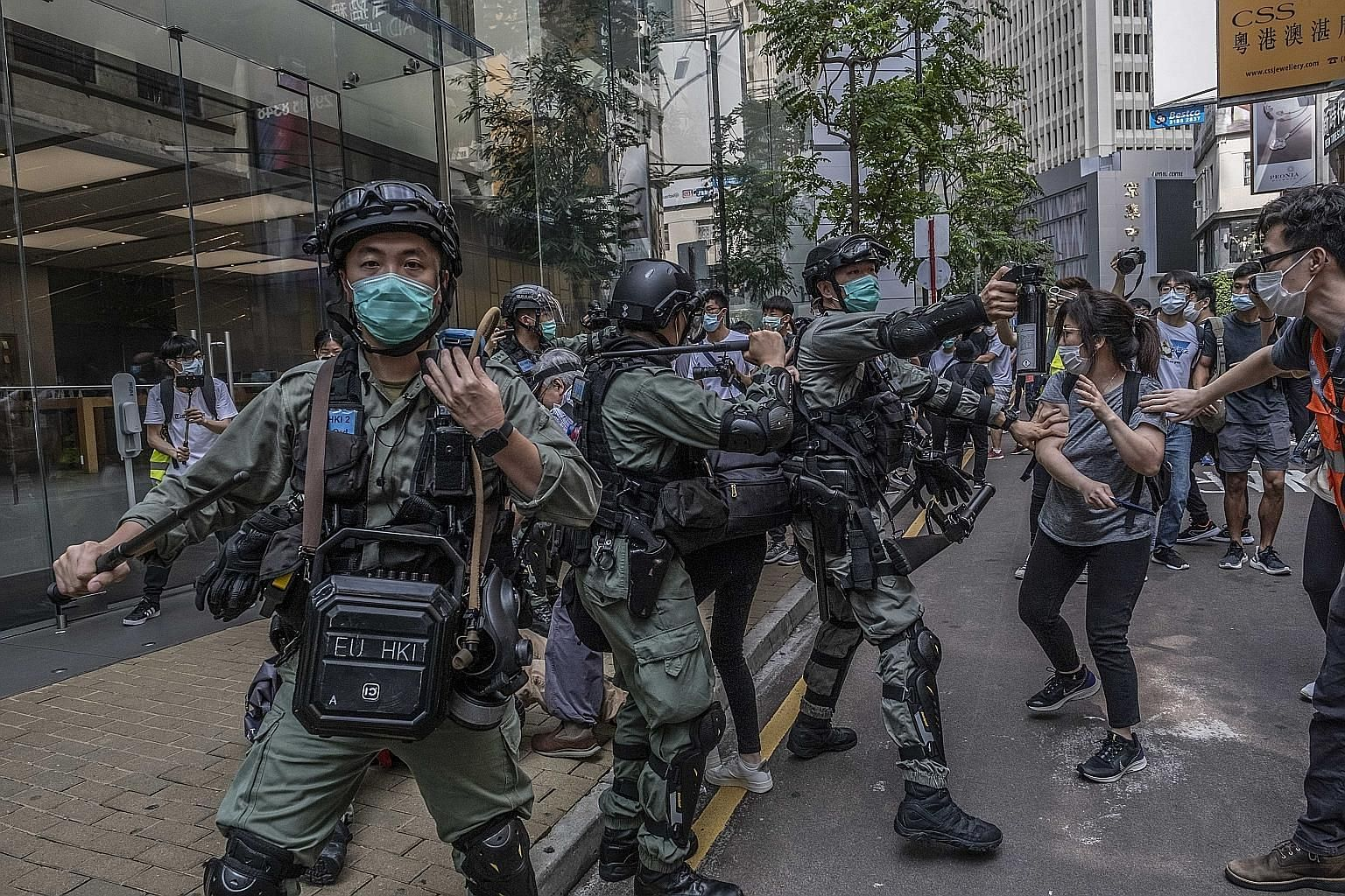 Hong Kong riot police clashing with protesters last month. Many questions have arisen over how the new national security law will be administrated, enforced and adjudicated. How this is put into practice has stoked great fear and opposition in the ci