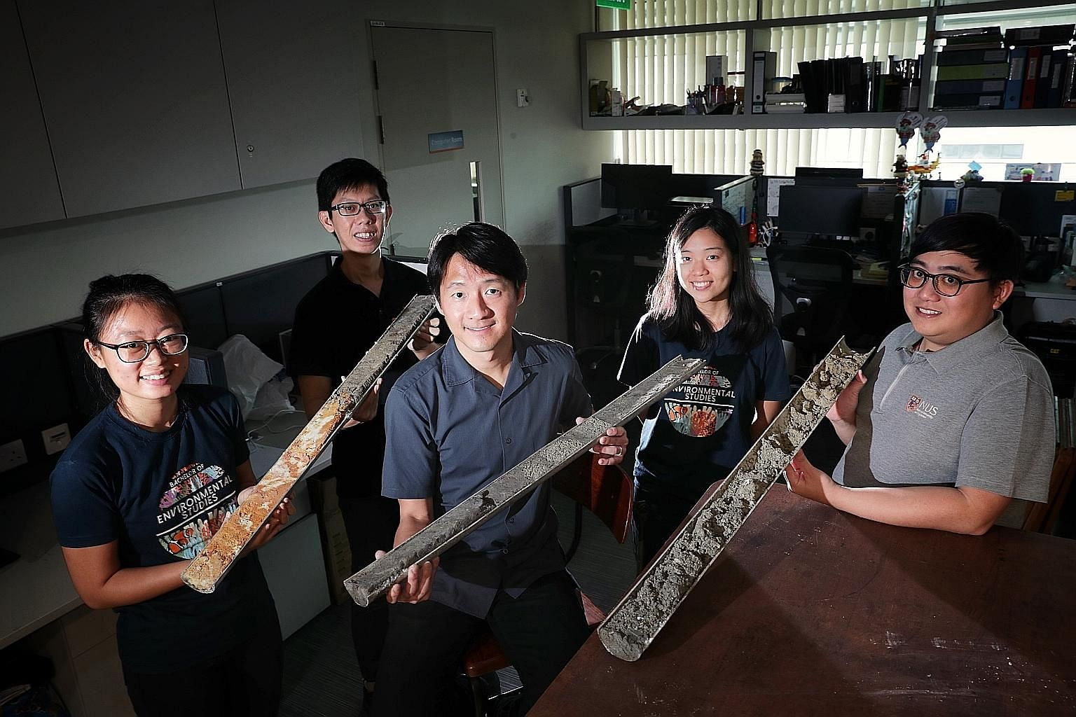 The study's principal investigator Huang Danwei (centre) and core members of his National University of Singapore team - (from left) research assistant Oh Ren Min, 24; PhD student Samuel Chan, 29; undergraduate Choo Min, 23; and research assistant Am