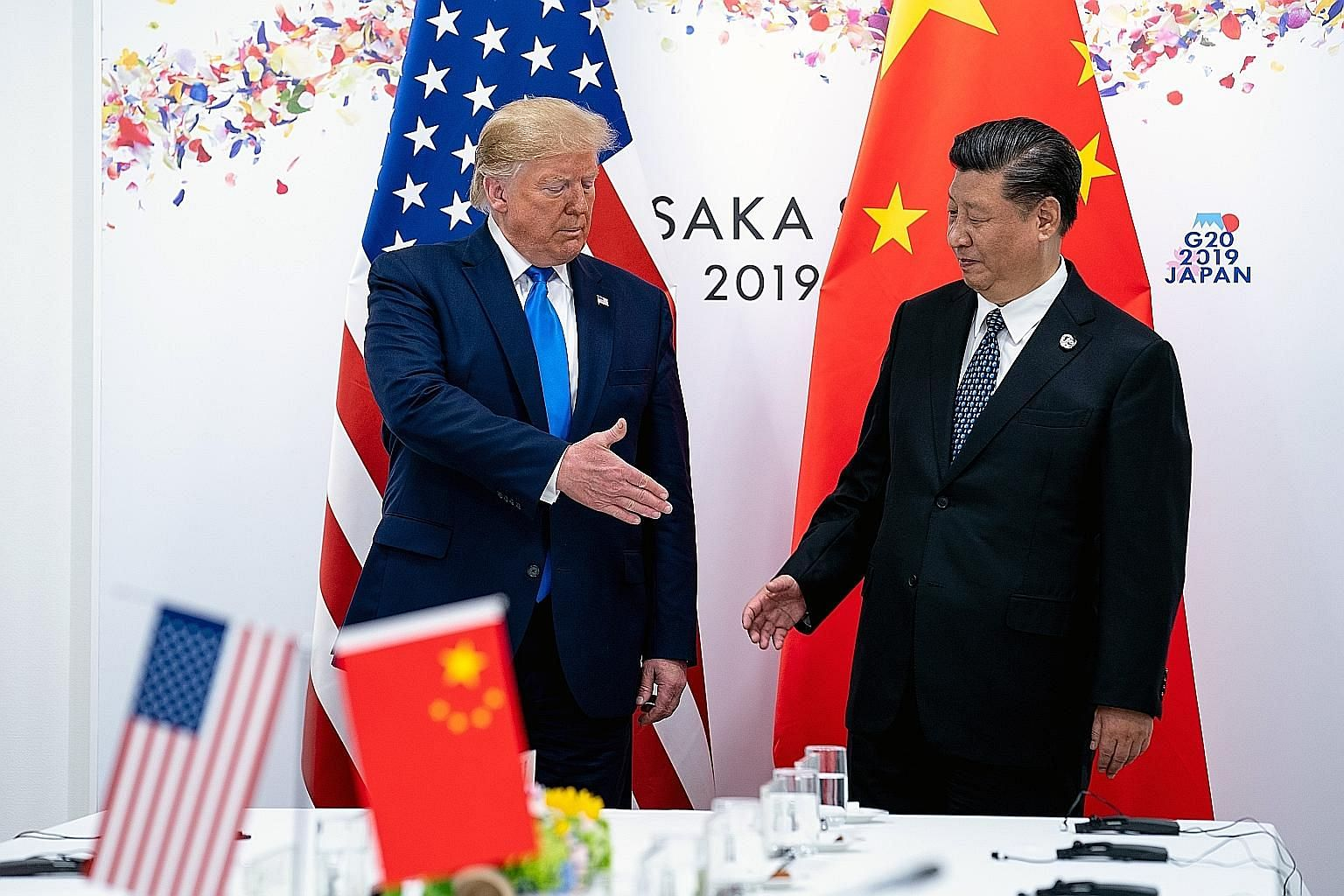 US President Donald Trump and China's leader Xi Jinping at a bilateral meeting at the Group of 20 summit in Japan last year. Shanghai-based former diplomat Kenneth Jarrett reckons that four more years of the Trump administration would give China more