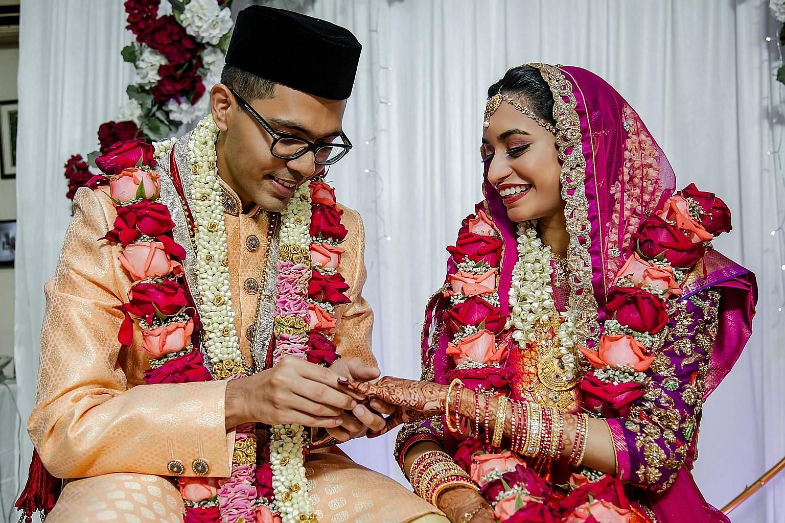 Chef Chung Deming and sports massage therapist Choy Zhen Fang had planned a 25-table wedding dThe past few months have been a long honeymoon for newlyweds Ashekul Ameen (left) and Rakeeza Sheren, who tied the knot in her family's Housing Board flat on Mar