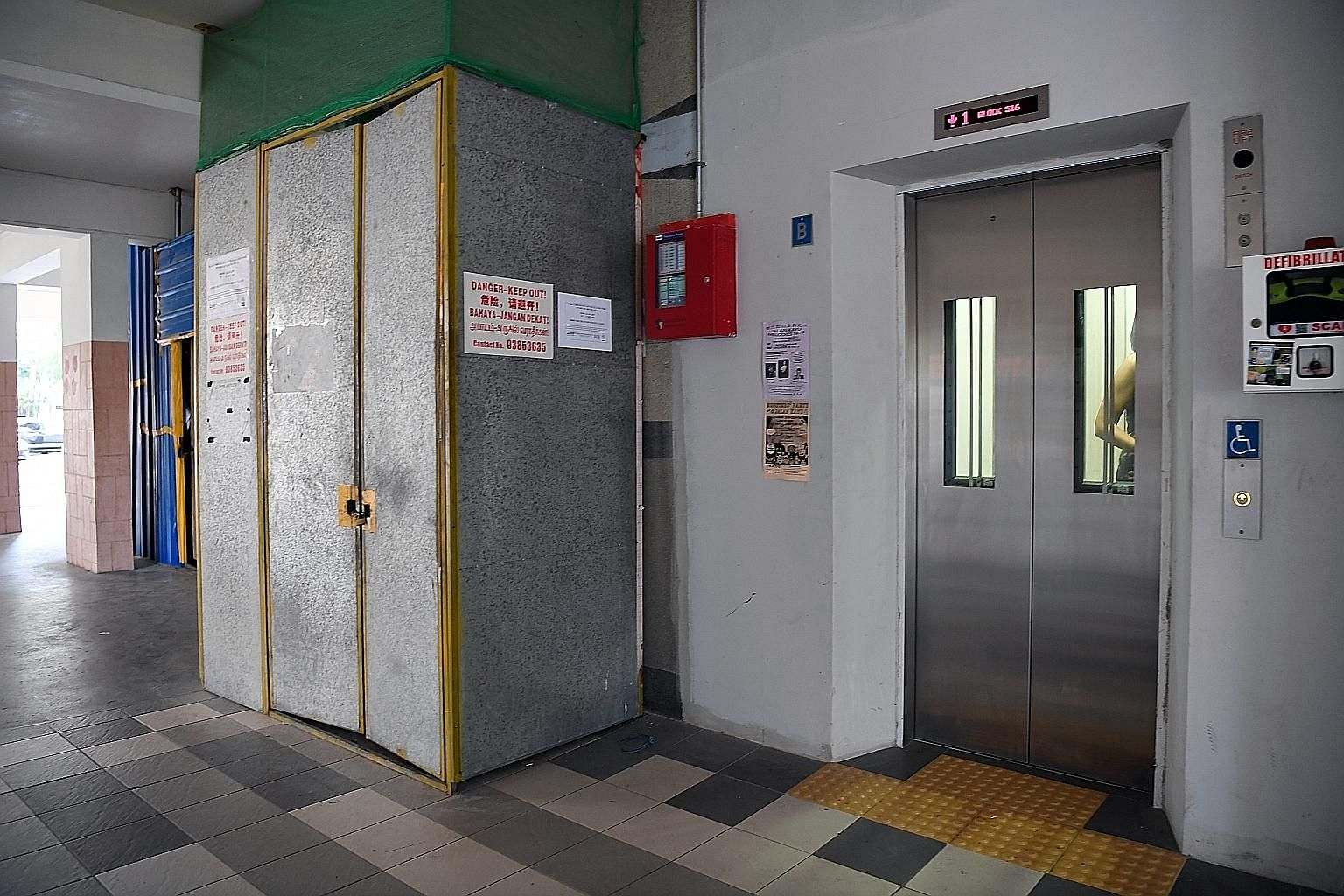 Lift upgrading taking place at an HDB block in Serangoon North last October. To date, contracts for the enhancement of 5,198 lifts in total within PAP town councils have been awarded, with a value of $107 million.