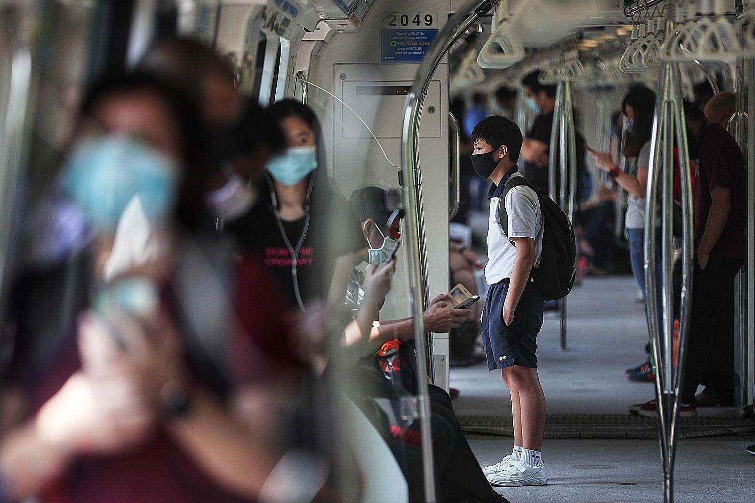 Commuters on an MRT train yesterday. As new evidence emerged, the authorities here changed their advice on the wearing of masks, and people's willingness to adapt has been invaluable in the fight against Covid-19, said Deputy Prime Minister Heng Swee