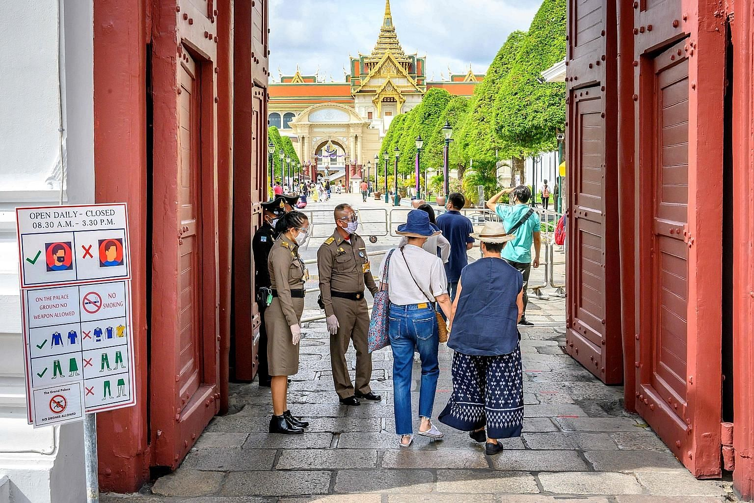 Visitors entering the Grand Palace in Bangkok on Sunday. Tourist attractions within 300km of Bangkok have welcomed 50 per cent to 70 per cent of their usual visitor numbers so far, said Tourism Council of Thailand president Chairat Trirattanajaraspor